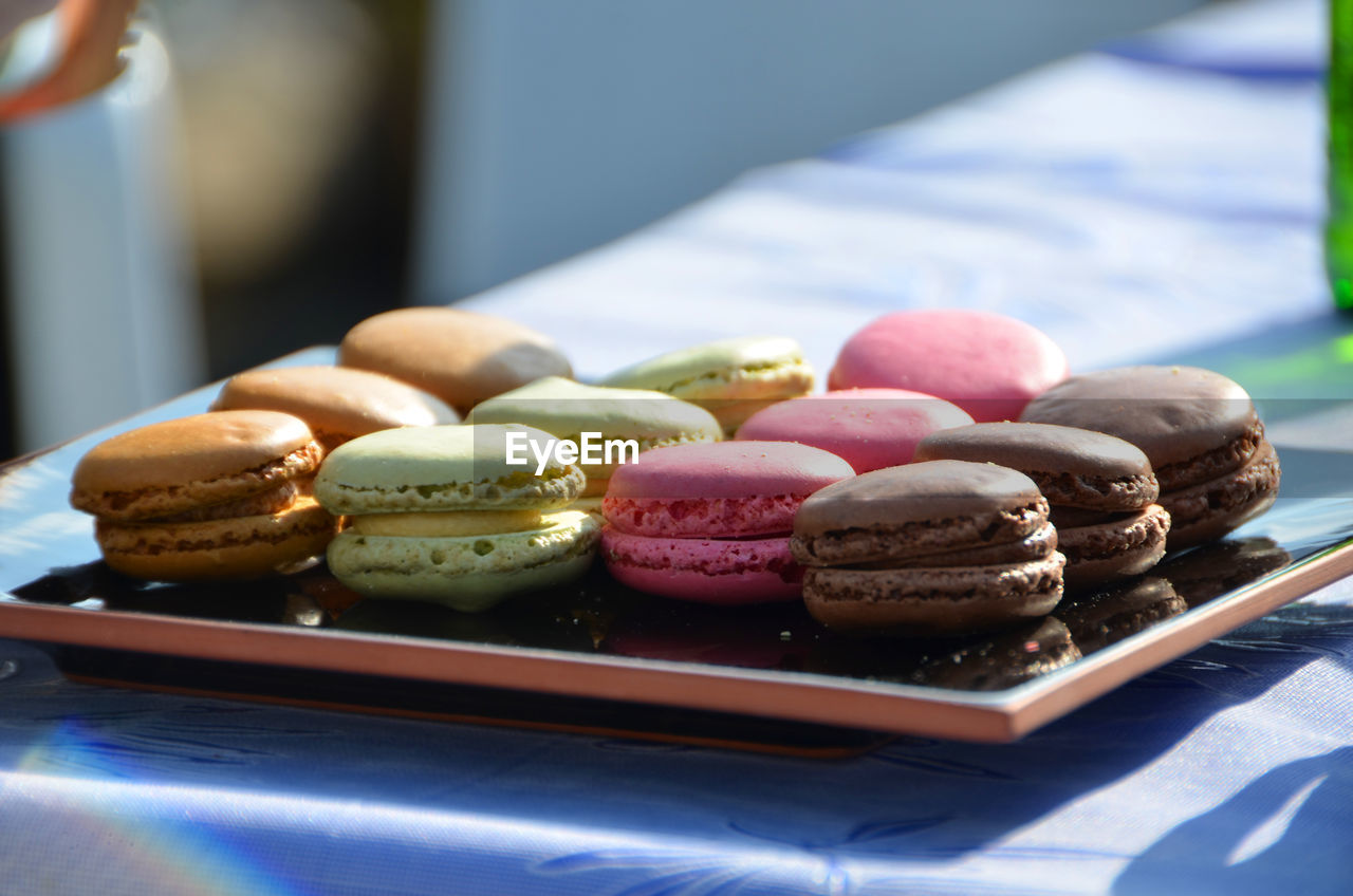 Freshly baked french macaroons at bakery shop