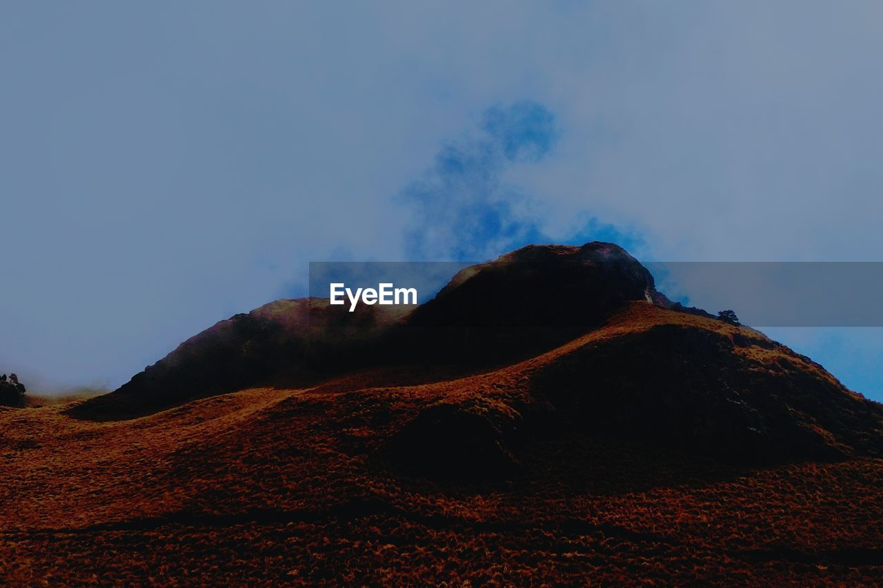 sky, mountain, beauty in nature, no people, nature, scenics - nature, tranquility, tranquil scene, non-urban scene, geology, environment, land, volcano, low angle view, landscape, cloud - sky, outdoors, day, rock, physical geography, mountain peak, power in nature, volcanic crater