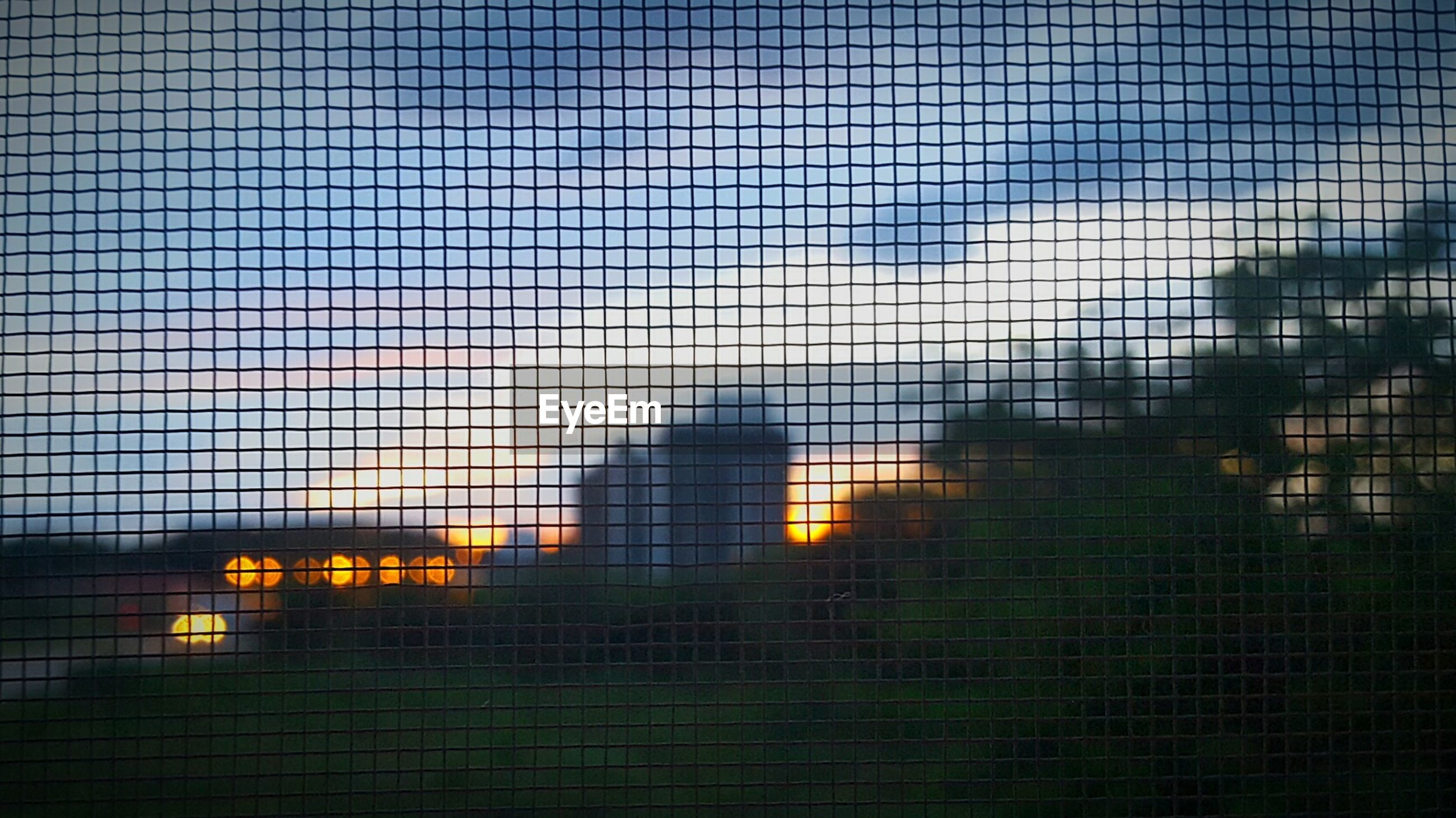 no people, pattern, chainlink fence, sky, architecture, built structure, sunset, building exterior, close-up, day, outdoors