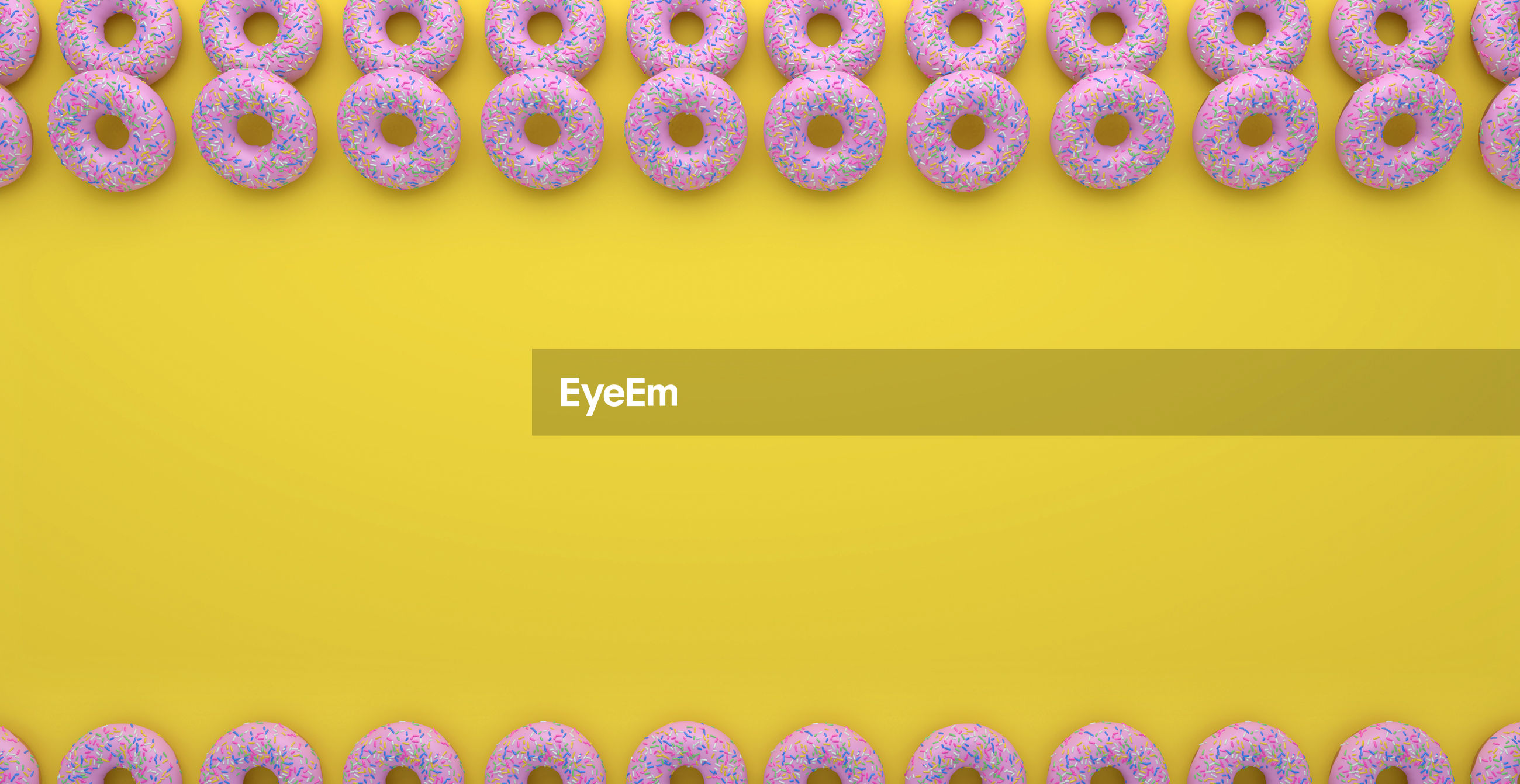 Pink donuts on yellow background