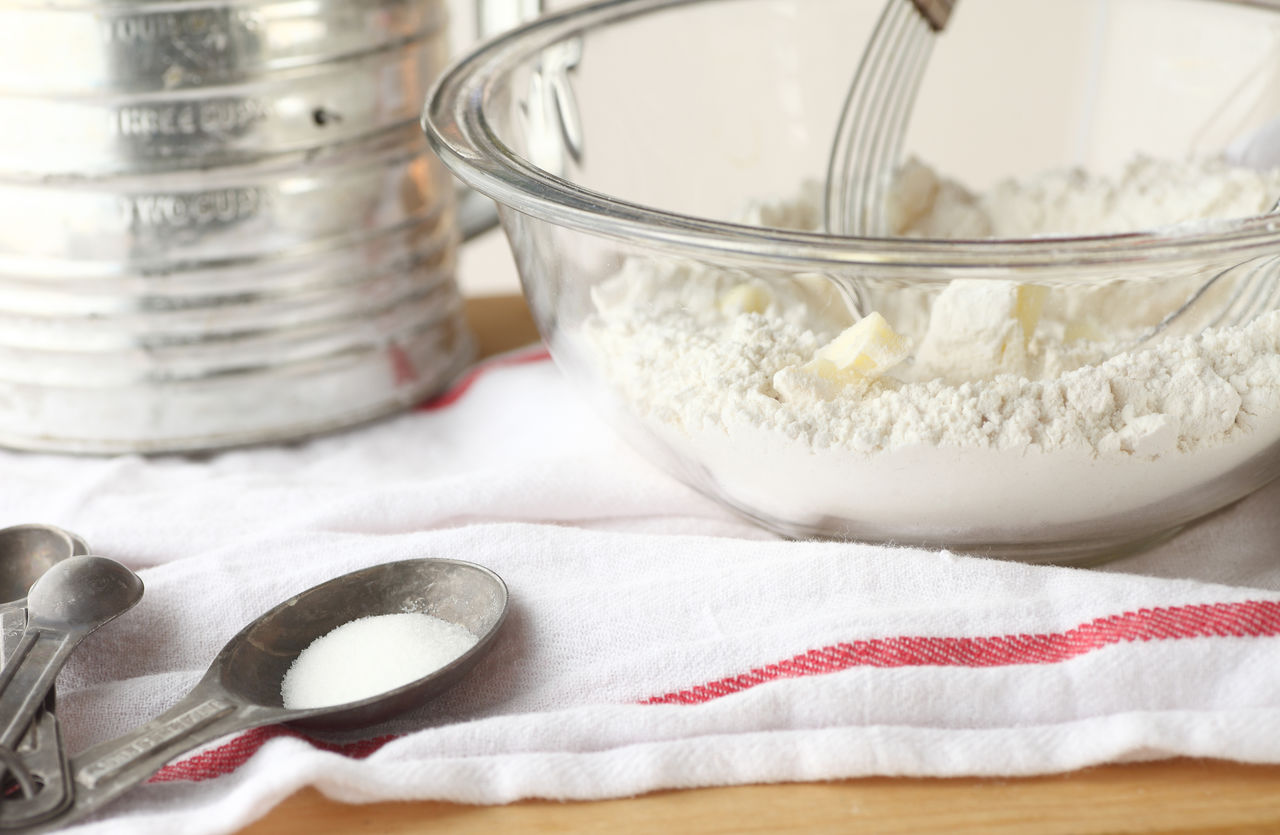 Close-Up Of Flour And Butter In Glass Bowl On Table