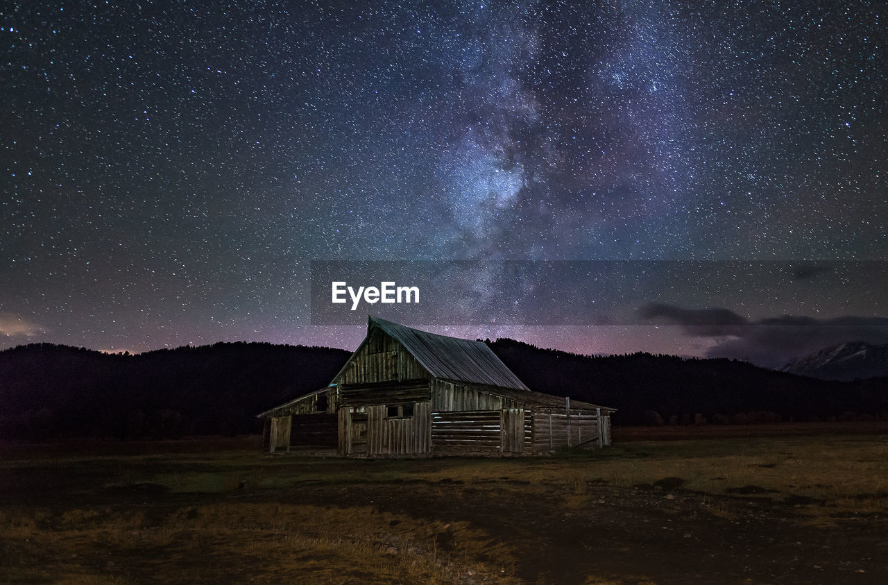 sky, architecture, built structure, mountain, building, building exterior, star - space, house, beauty in nature, scenics - nature, night, galaxy, landscape, nature, no people, tranquility, tranquil scene, space, field, astronomy, outdoors, milky way, cottage