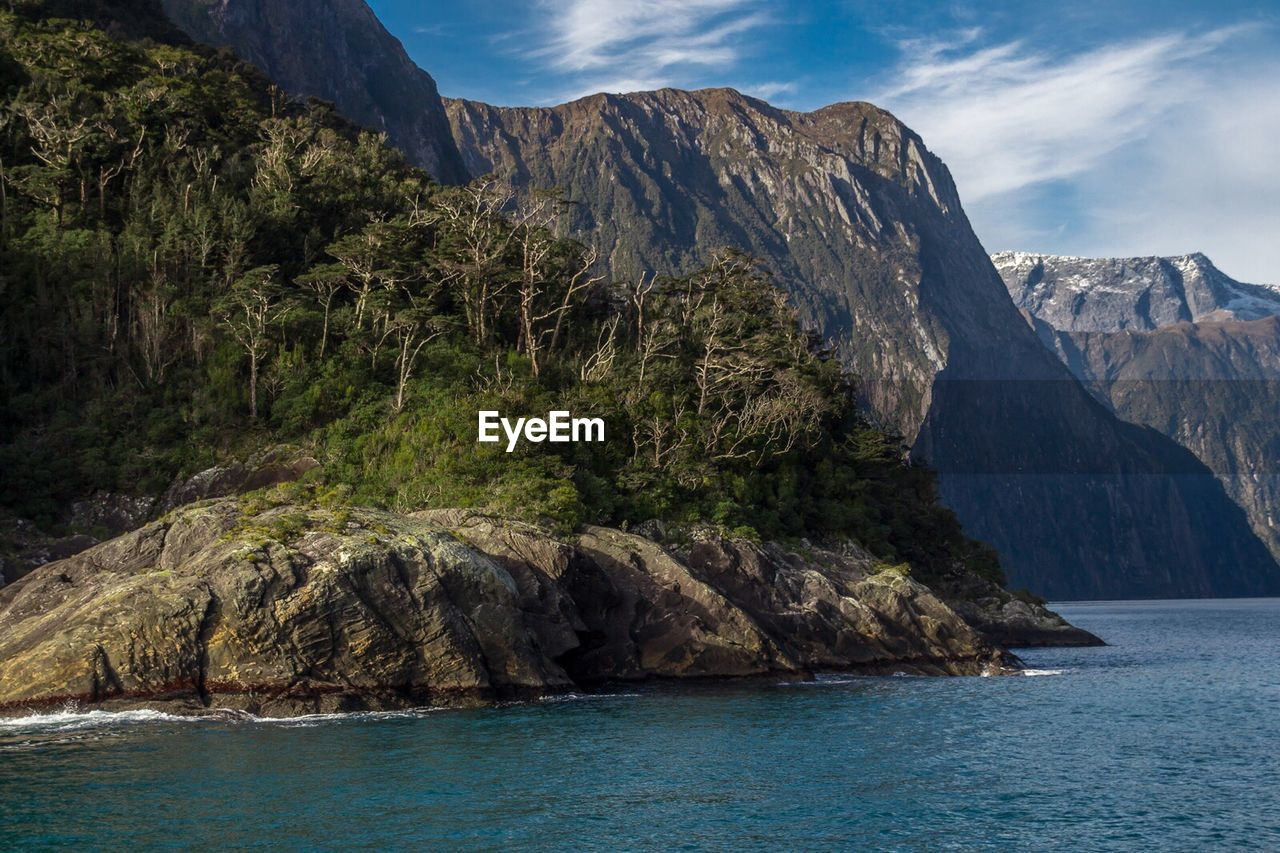 mountain, nature, scenics, rock - object, waterfront, landscape, beauty in nature, mountain range, no people, cliff, sea, outdoors, sky, water, day, scenery