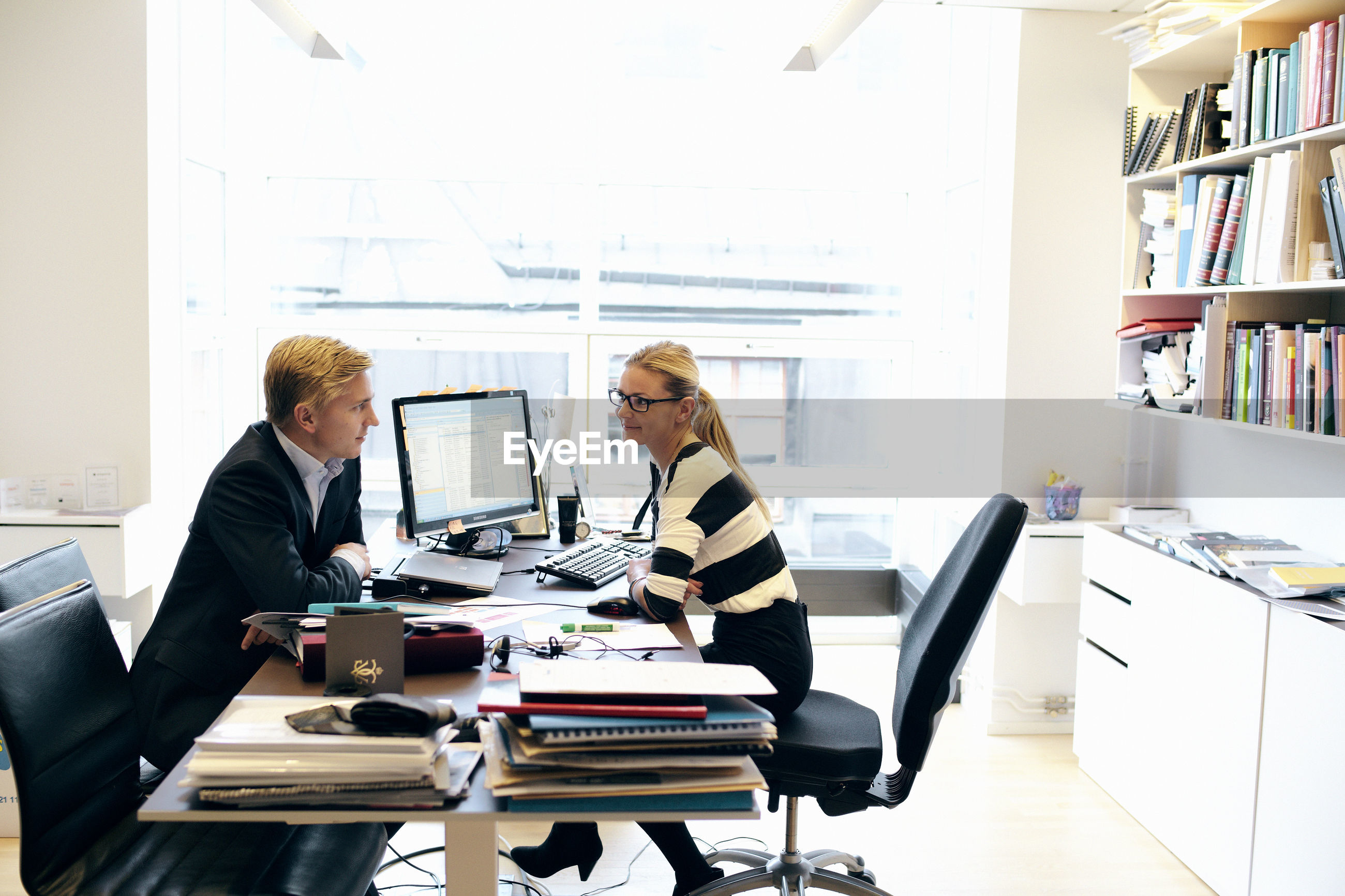 PEOPLE WORKING ON TABLE IN OFFICE