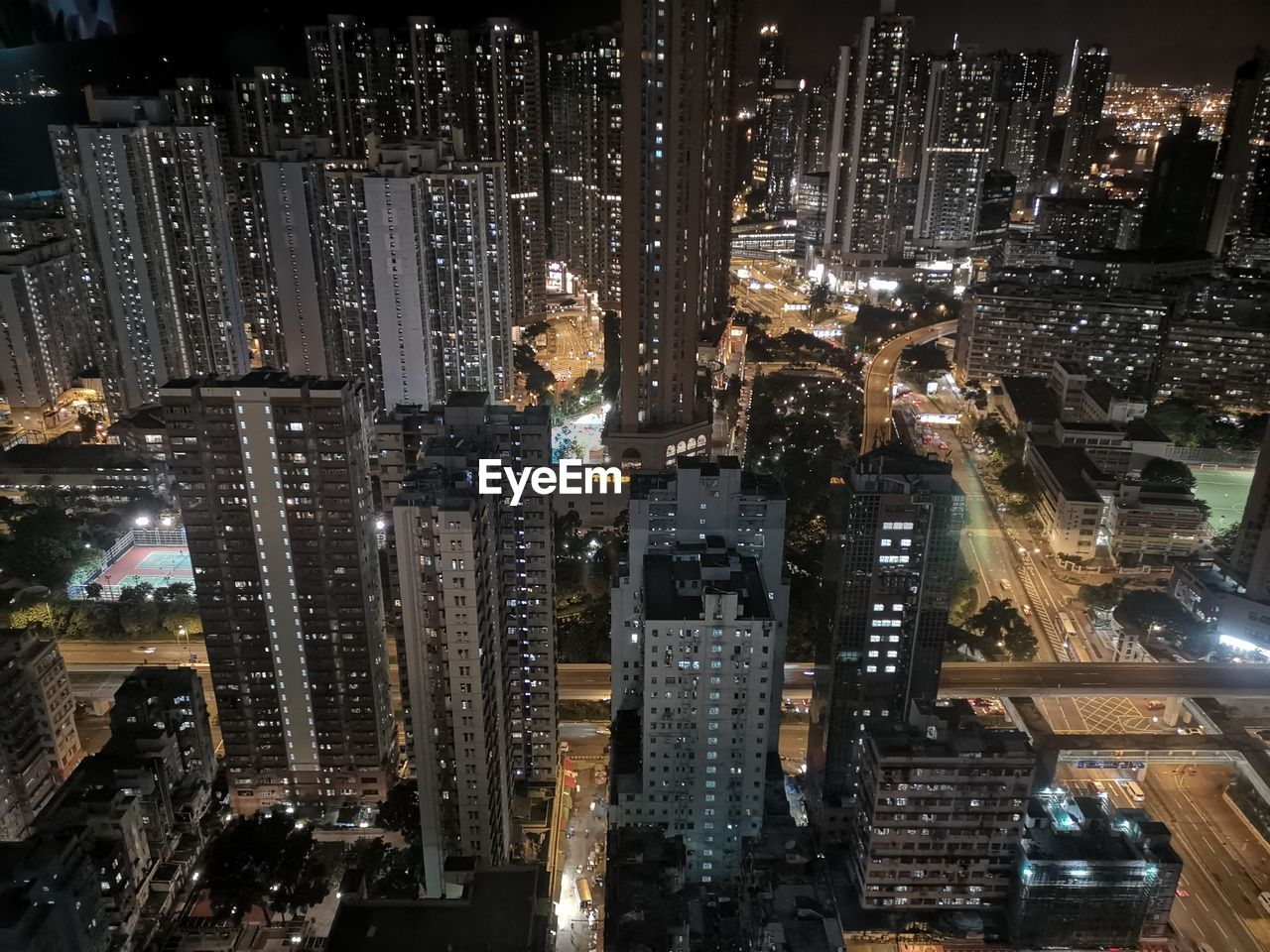 city, night, illuminated, building exterior, cityscape, architecture, skyscraper, built structure, building, office building exterior, crowd, city life, crowded, tall - high, tower, modern, high angle view, office, residential district, outdoors, financial district, nightlife