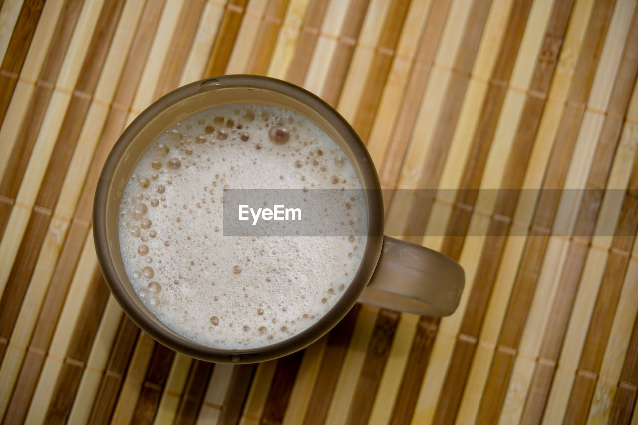 food and drink, food, indoors, directly above, freshness, refreshment, drink, high angle view, still life, no people, coffee, close-up, coffee - drink, wood - material, wellbeing, cup, mug, coffee cup, table, healthy eating, place mat, snack, crockery, spaghetti
