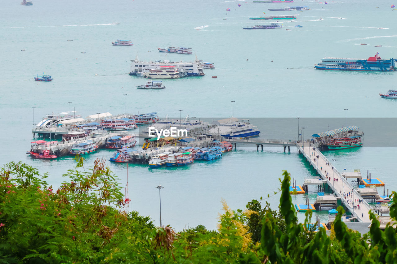 nautical vessel, water, transportation, mode of transportation, high angle view, harbor, sea, moored, nature, day, no people, ship, pier, tranquility, travel, plant, outdoors, freight transportation, shipping, bay, marina, sailboat, fishing boat, port