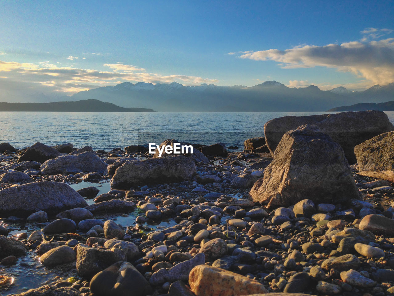 water, sky, sea, rock, solid, beauty in nature, scenics - nature, beach, cloud - sky, land, rock - object, tranquility, tranquil scene, nature, no people, idyllic, mountain, remote, non-urban scene, horizon over water, outdoors, pebble, rocky coastline