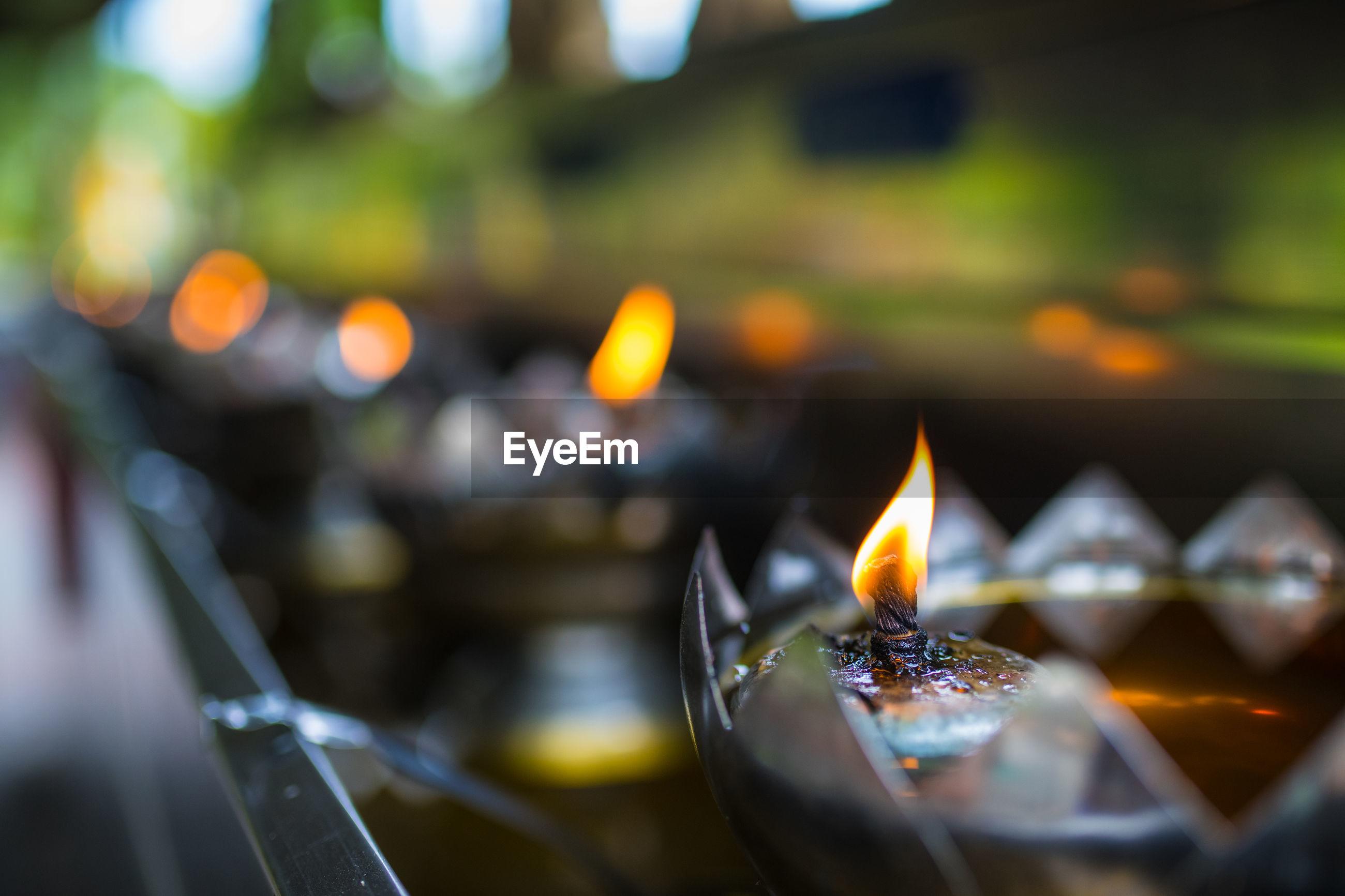 Close-up of lit oil lamp
