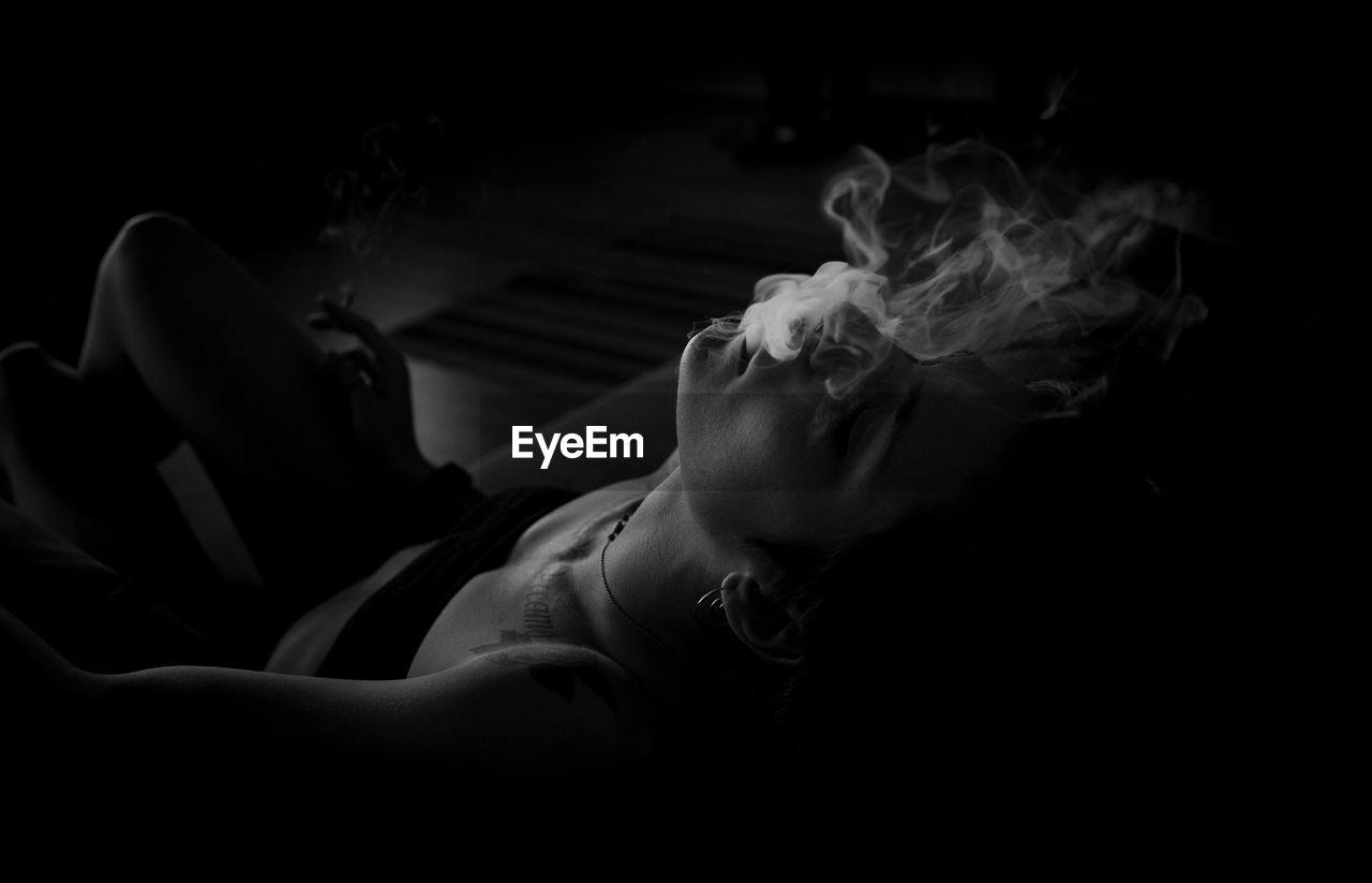 a moody cigarette Smoke The Portraitist - 2019 EyeEm Awards Black Background Human Hand Close-up Smoking Cigarette Lighter Bad Habit Cigarette  Addiction Smoking - Activity My Best Photo