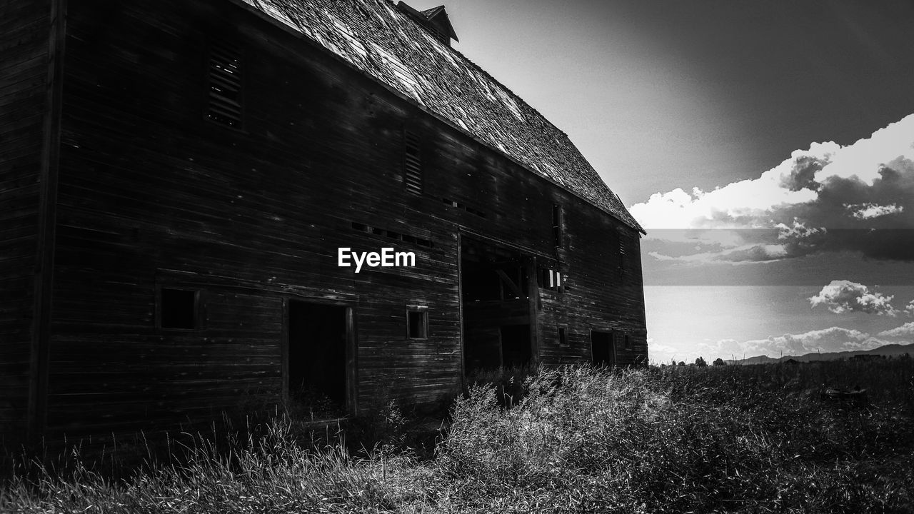 architecture, built structure, abandoned, sky, building exterior, land, building, nature, run-down, damaged, obsolete, cloud - sky, field, grass, plant, old, no people, decline, day, landscape, deterioration, outdoors, ruined
