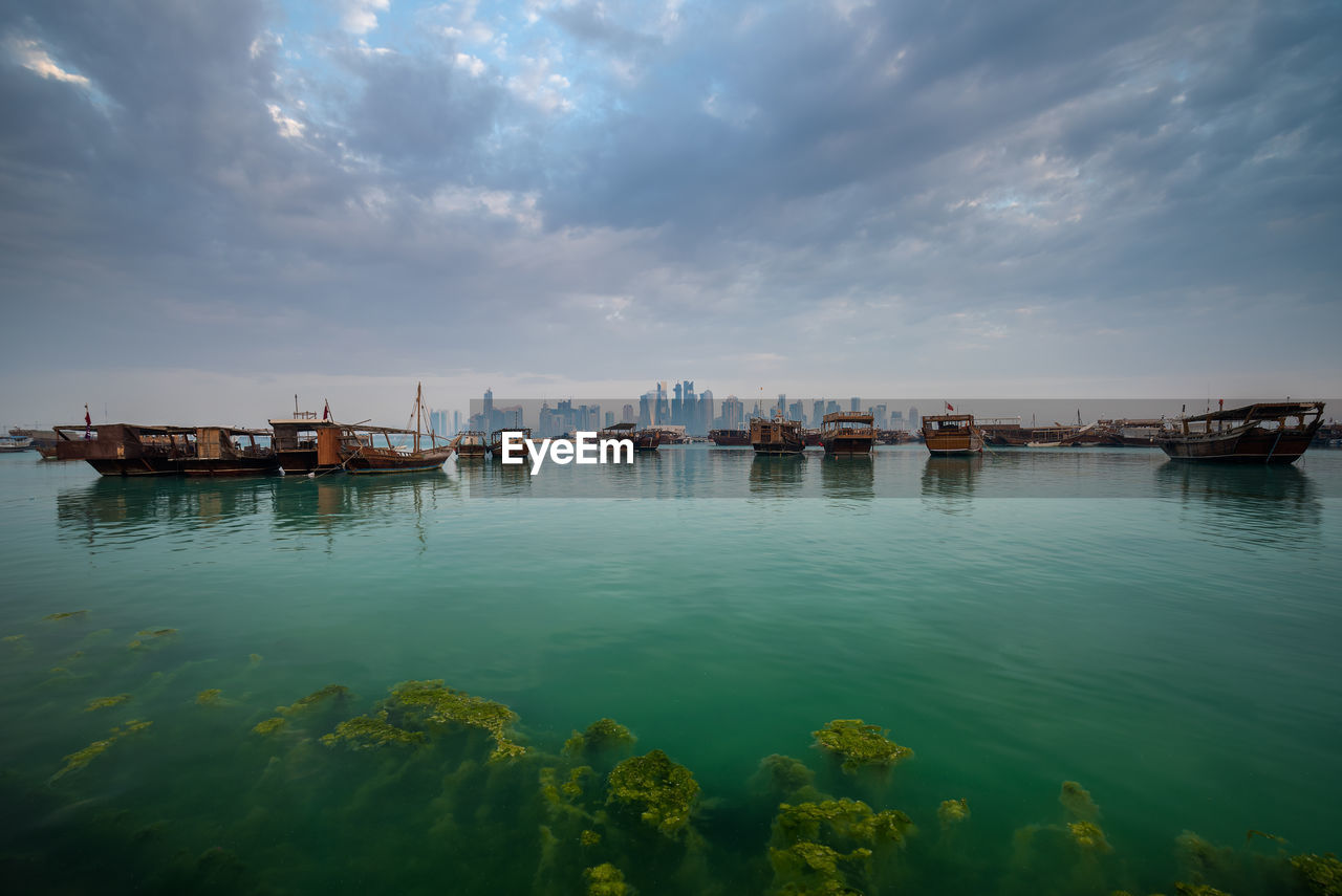 water, sky, cloud - sky, nautical vessel, waterfront, no people, nature, sea, transportation, scenics - nature, beauty in nature, architecture, reflection, outdoors, day, tranquility, idyllic, built structure, building exterior, marina