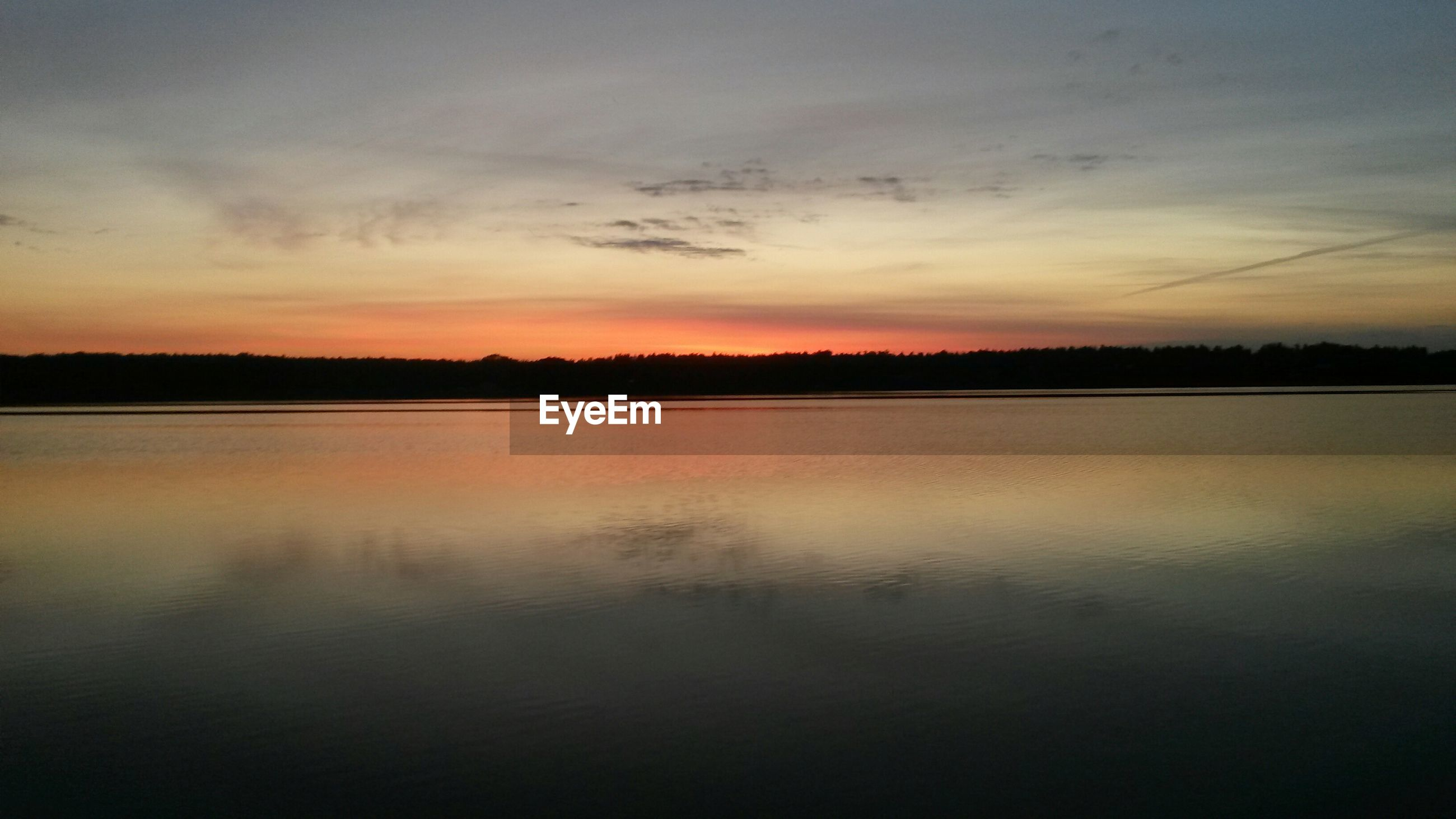 sunset, tranquil scene, reflection, scenics, tranquility, water, beauty in nature, lake, sky, silhouette, idyllic, nature, waterfront, orange color, cloud - sky, calm, standing water, dusk, non-urban scene, outdoors