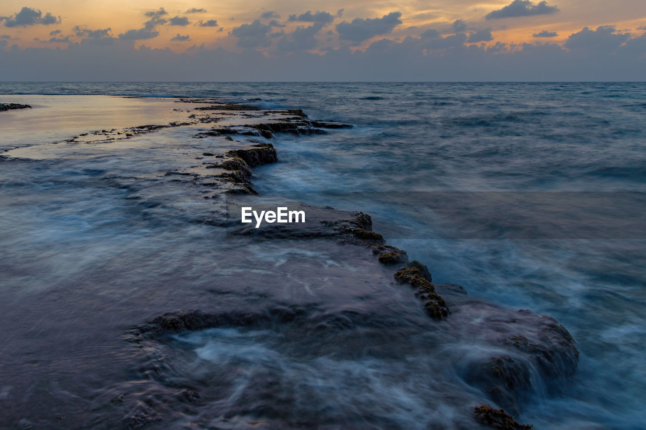 sea, water, sky, motion, beauty in nature, scenics - nature, horizon over water, beach, sunset, horizon, wave, cloud - sky, land, no people, tranquility, nature, sport, rock, aquatic sport, outdoors, rocky coastline, power in nature