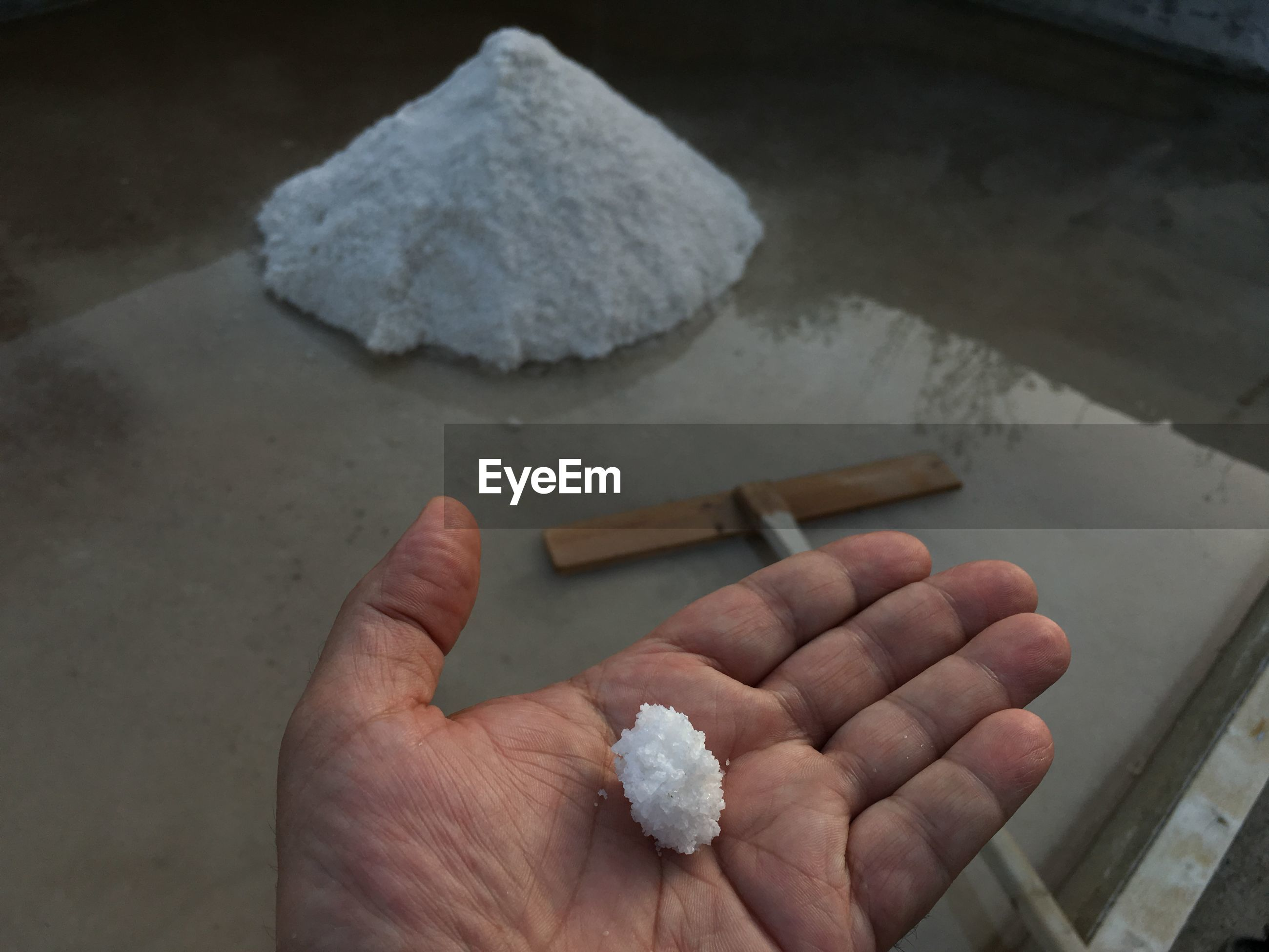 Cropped hand of person holding salt