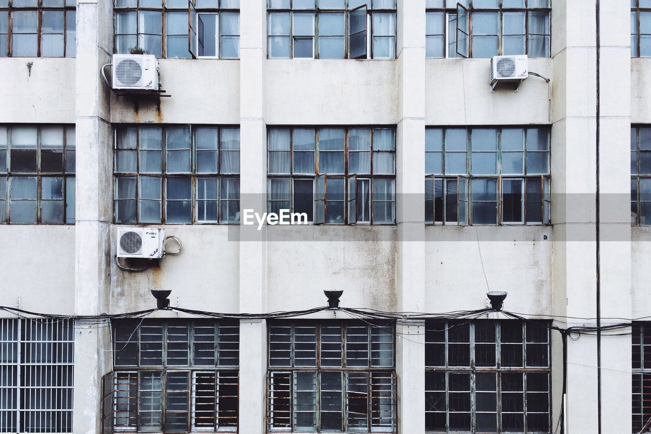 Old Industrial Building With Rusty Window Frames