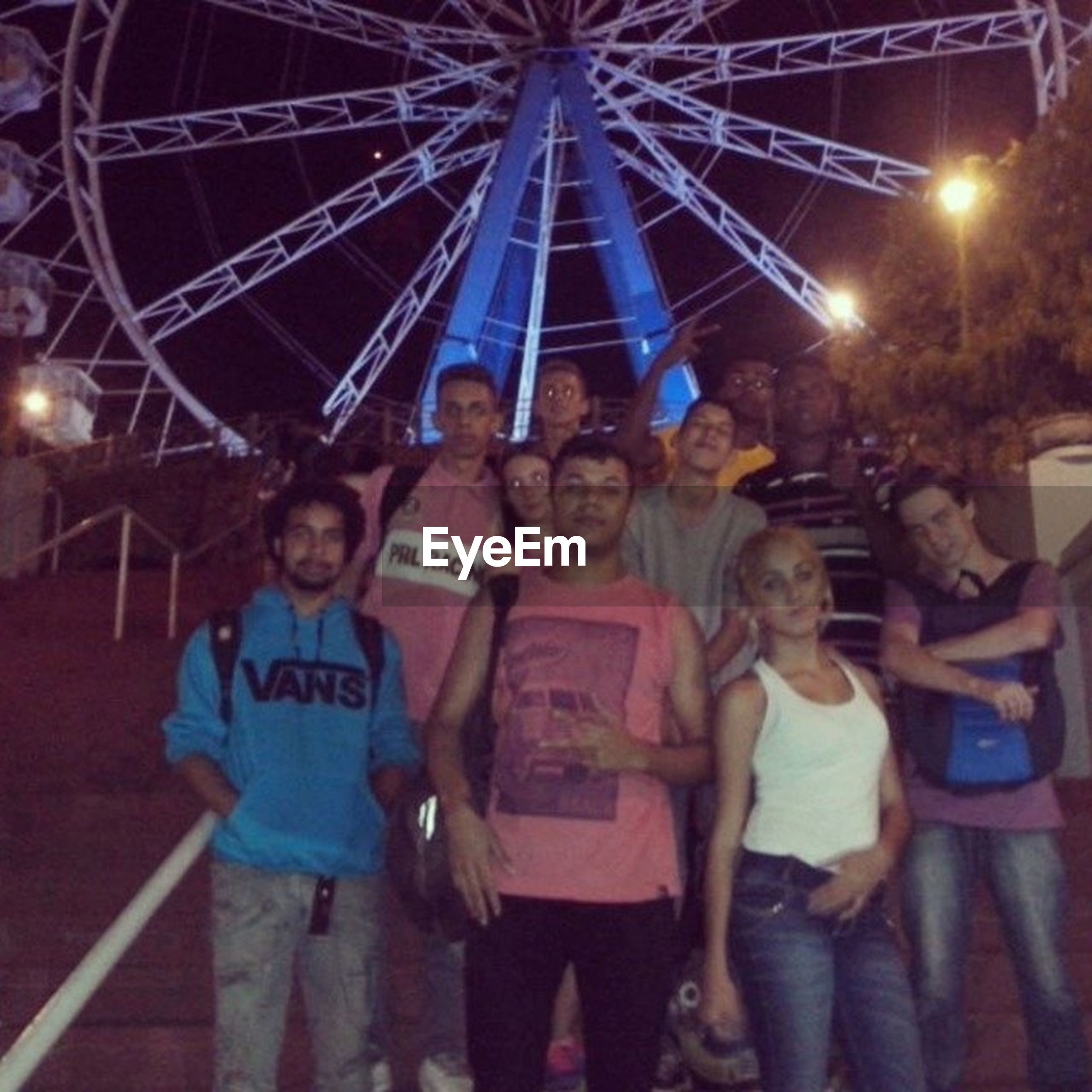 lifestyles, leisure activity, illuminated, arts culture and entertainment, large group of people, men, night, fun, enjoyment, person, amusement park, amusement park ride, togetherness, celebration, standing, event, holding, casual clothing, excitement