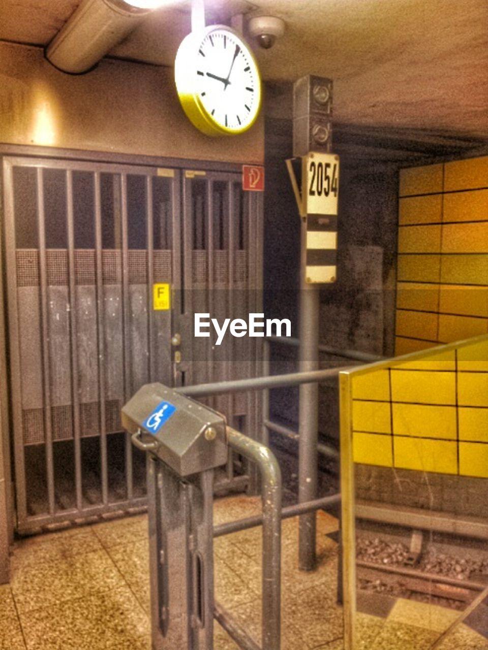time, subway station, public transportation, train - vehicle, indoors, clock, night, no people, illuminated, subway train
