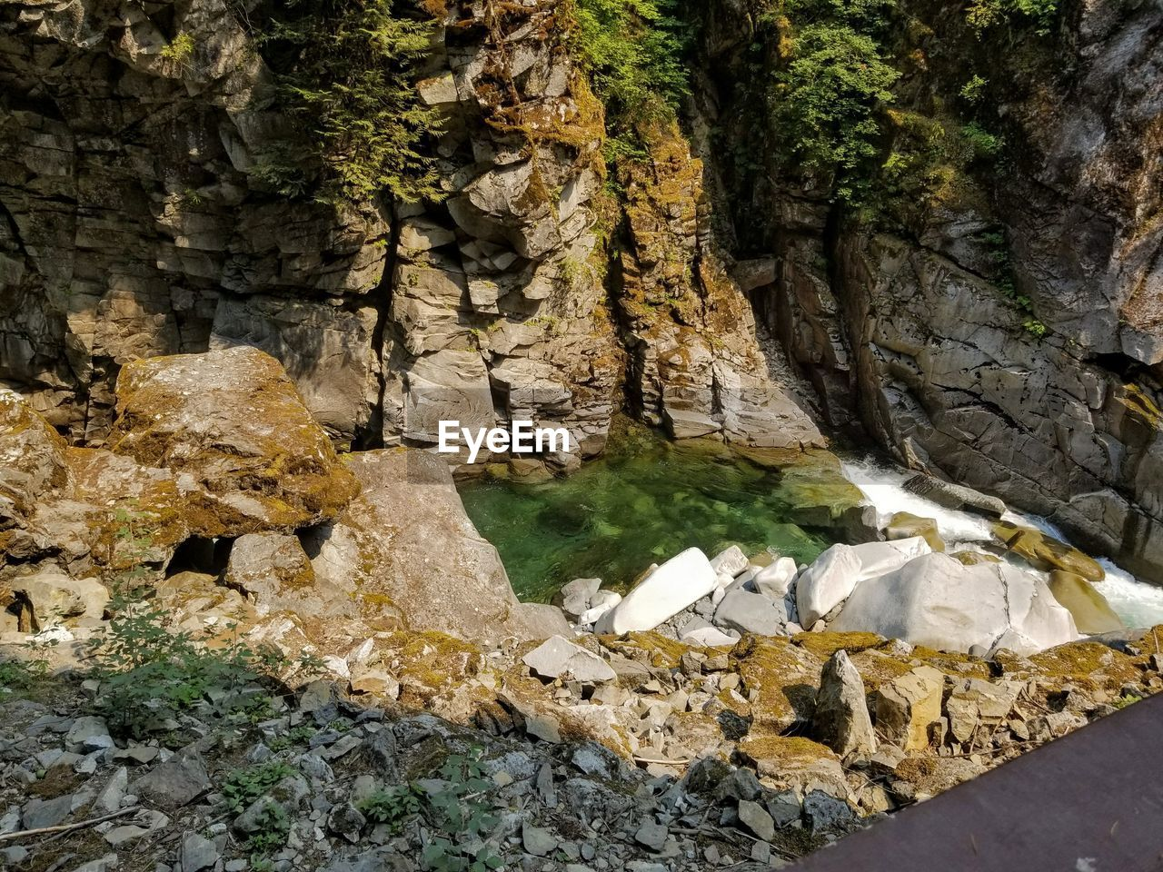 rock, rock - object, solid, nature, day, no people, beauty in nature, water, tree, outdoors, textured, land, rock formation, plant, geology, river, tranquility, close-up, rough, flowing water