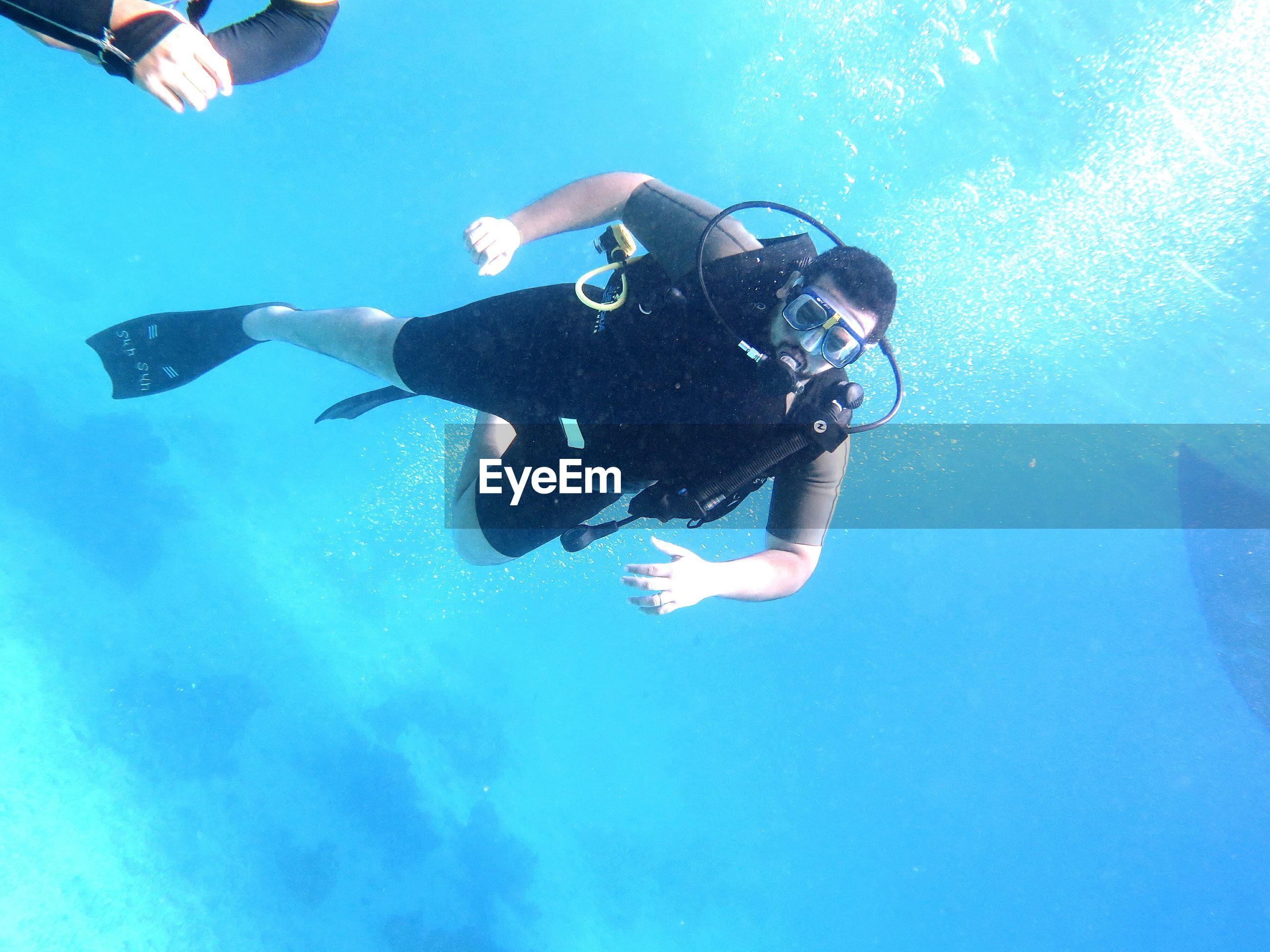 Low angle view of man snorkeling in sea
