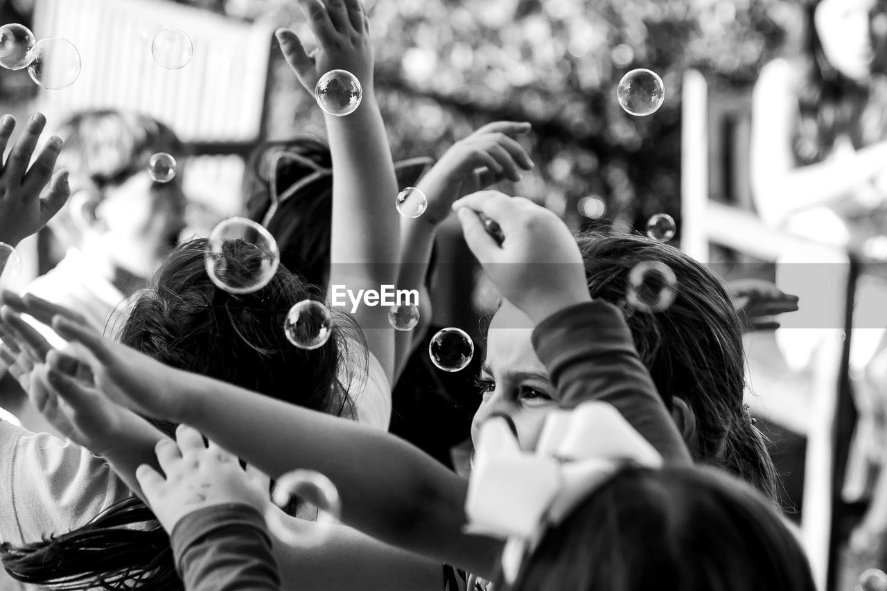 real people, group of people, crowd, large group of people, arms raised, selective focus, women, leisure activity, adult, human arm, day, lifestyles, architecture, hand, photography themes, togetherness, bubble, enjoyment, men, spectator, hand raised