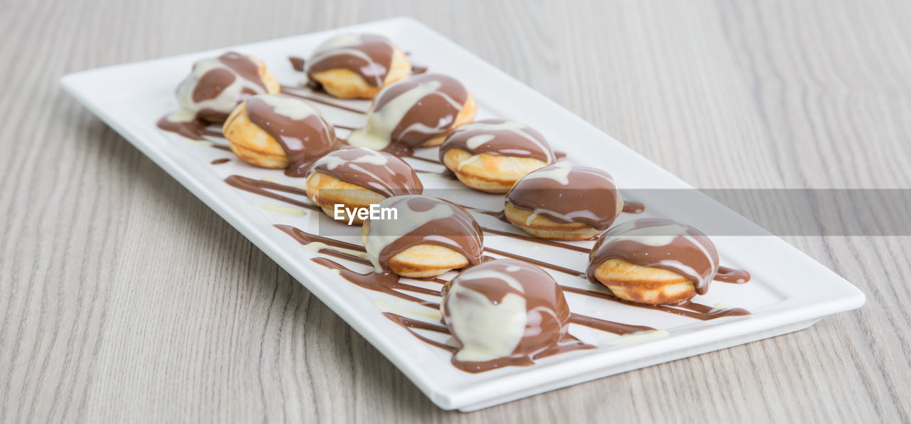 Close-up of dessert in tray on table