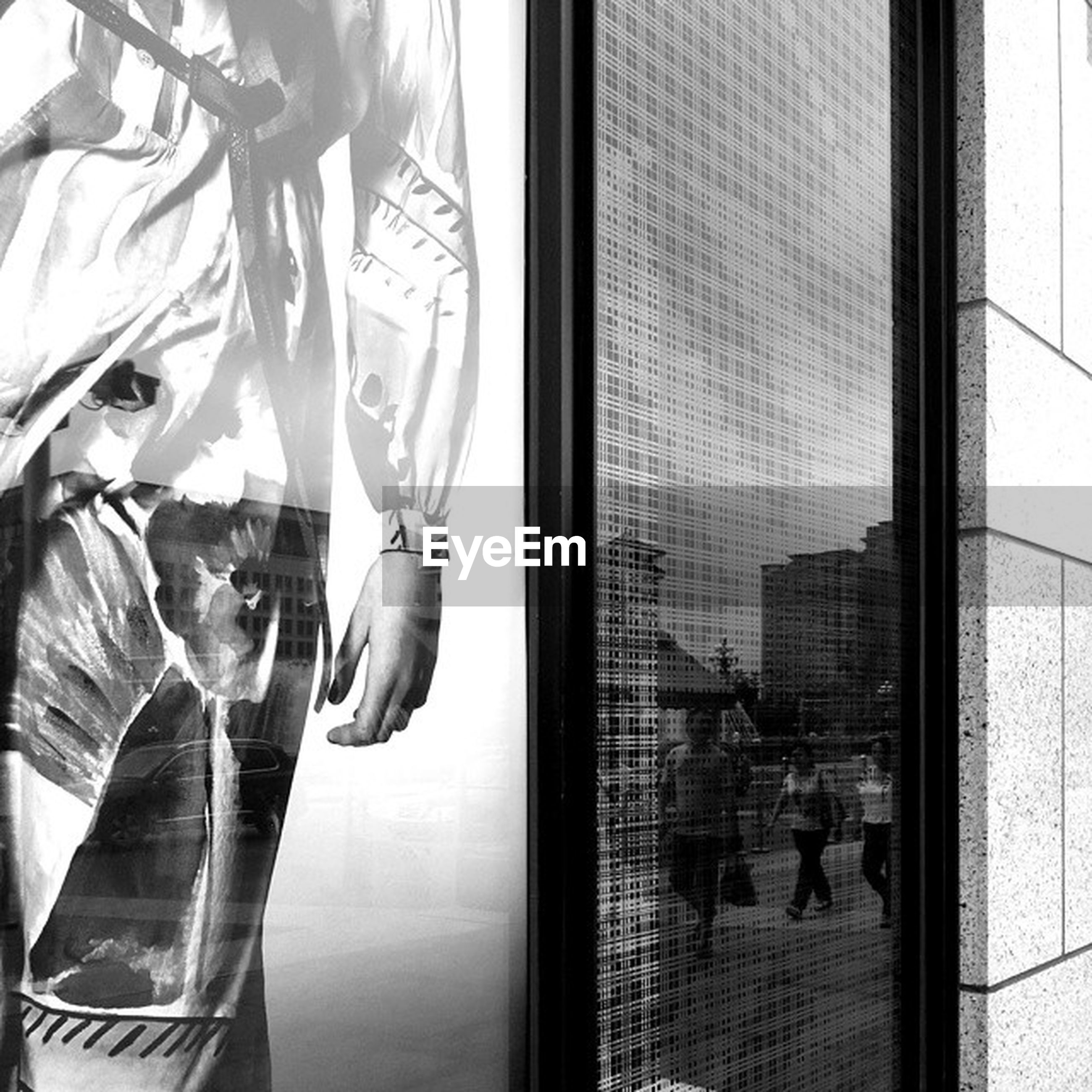glass - material, window, indoors, transparent, reflection, architecture, built structure, lifestyles, glass, building exterior, men, modern, person, leisure activity, city, curtain, day, looking through window
