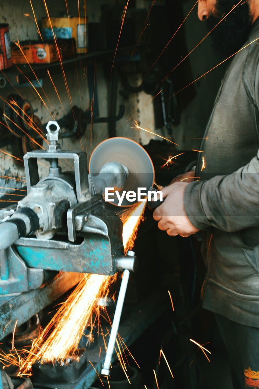 Close-Up Mid Section Of Welder At Work