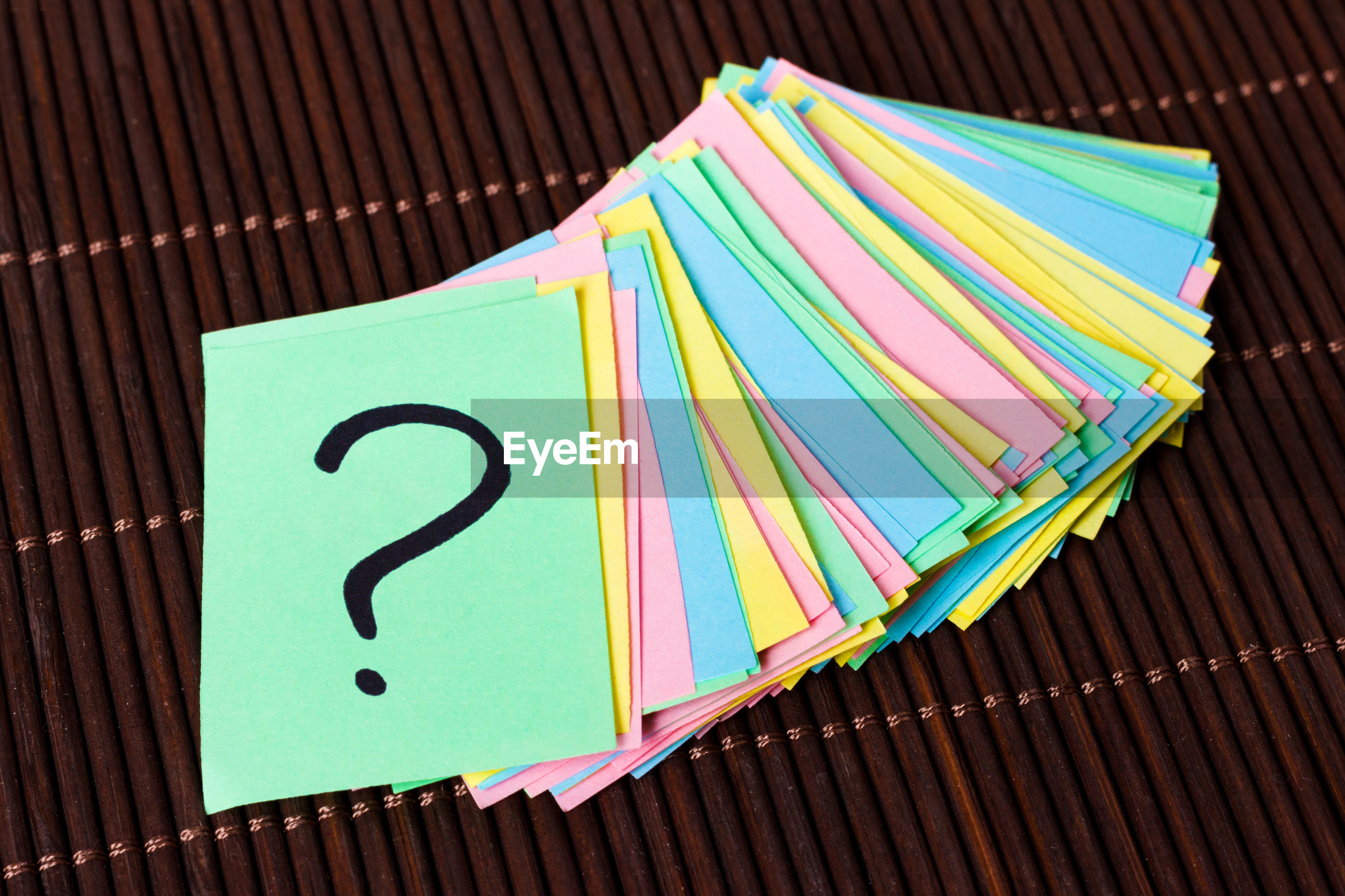 High angle view of colorful adhesive notes on table