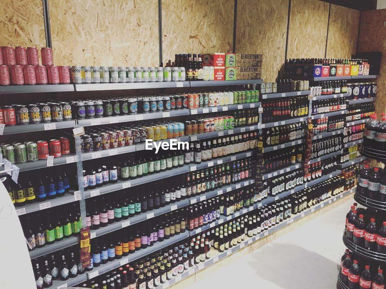 shelf, large group of objects, variation, indoors, choice, in a row, retail, bottle, abundance, arrangement, store, for sale, food and drink, multi colored, stack, alcohol, no people, wine, drink, supermarket, day