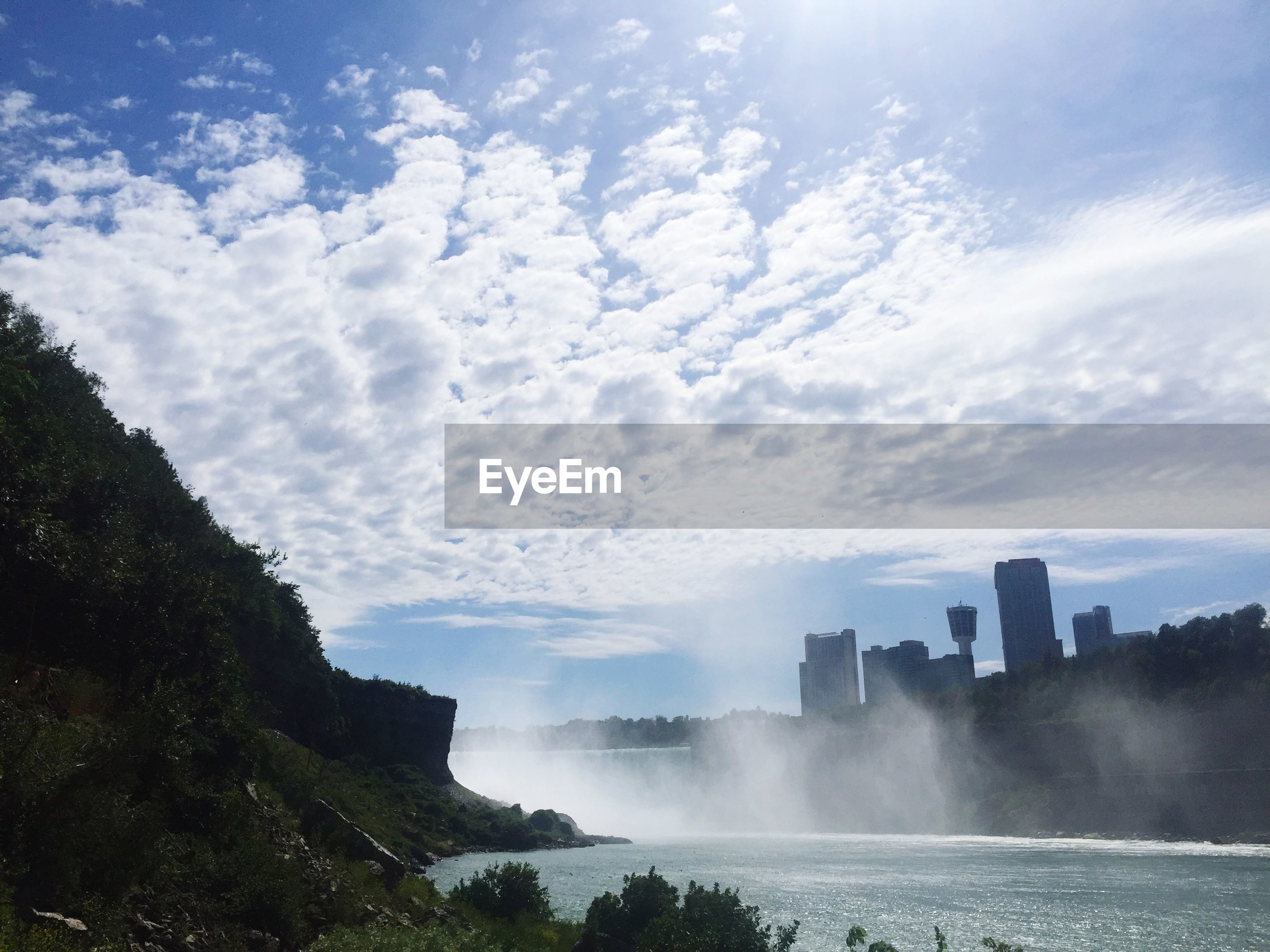 water, sky, cloud - sky, sea, scenics, beauty in nature, nature, building exterior, built structure, architecture, city, motion, cloud, day, outdoors, rock - object, river, tranquil scene, skyscraper, waterfront