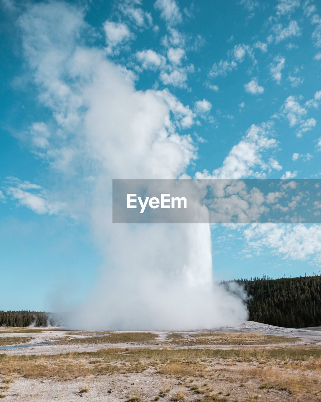 SCENIC VIEW OF GEYSER AGAINST SKY