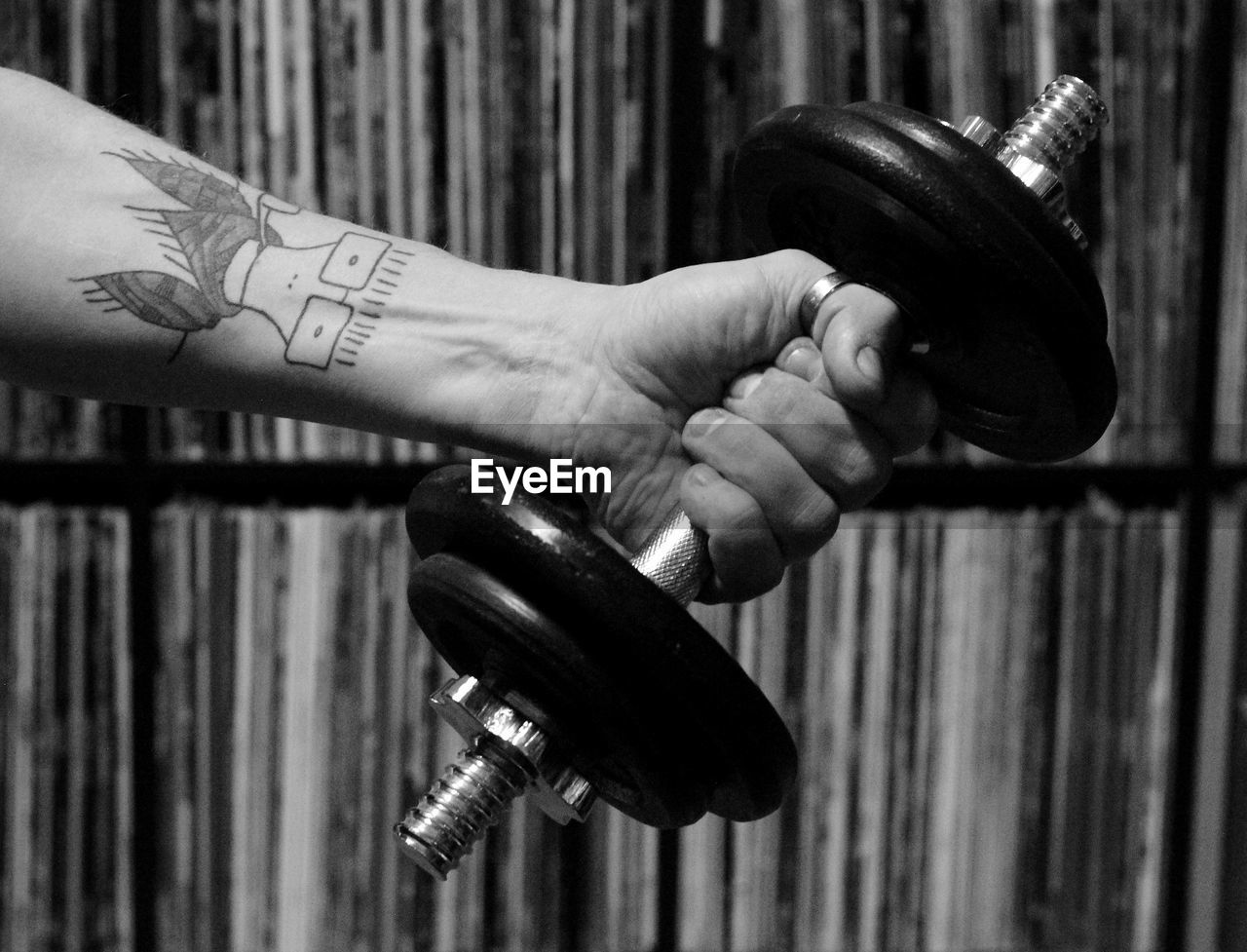 human hand, human body part, hand, focus on foreground, tattoo, muscular build, strength, one person, holding, dumbbell, sport, lifestyles, exercise equipment, sports training, close-up, indoors, exercising, sports equipment, weights, weight training, human limb