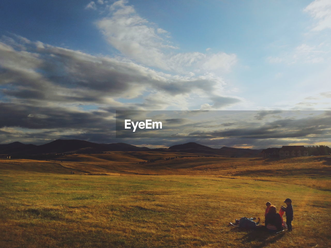 sky, cloud - sky, two people, scenics - nature, landscape, beauty in nature, environment, men, tranquil scene, tranquility, real people, field, mountain, land, nature, leisure activity, lifestyles, non-urban scene, people, togetherness, positive emotion, outdoors, couple - relationship
