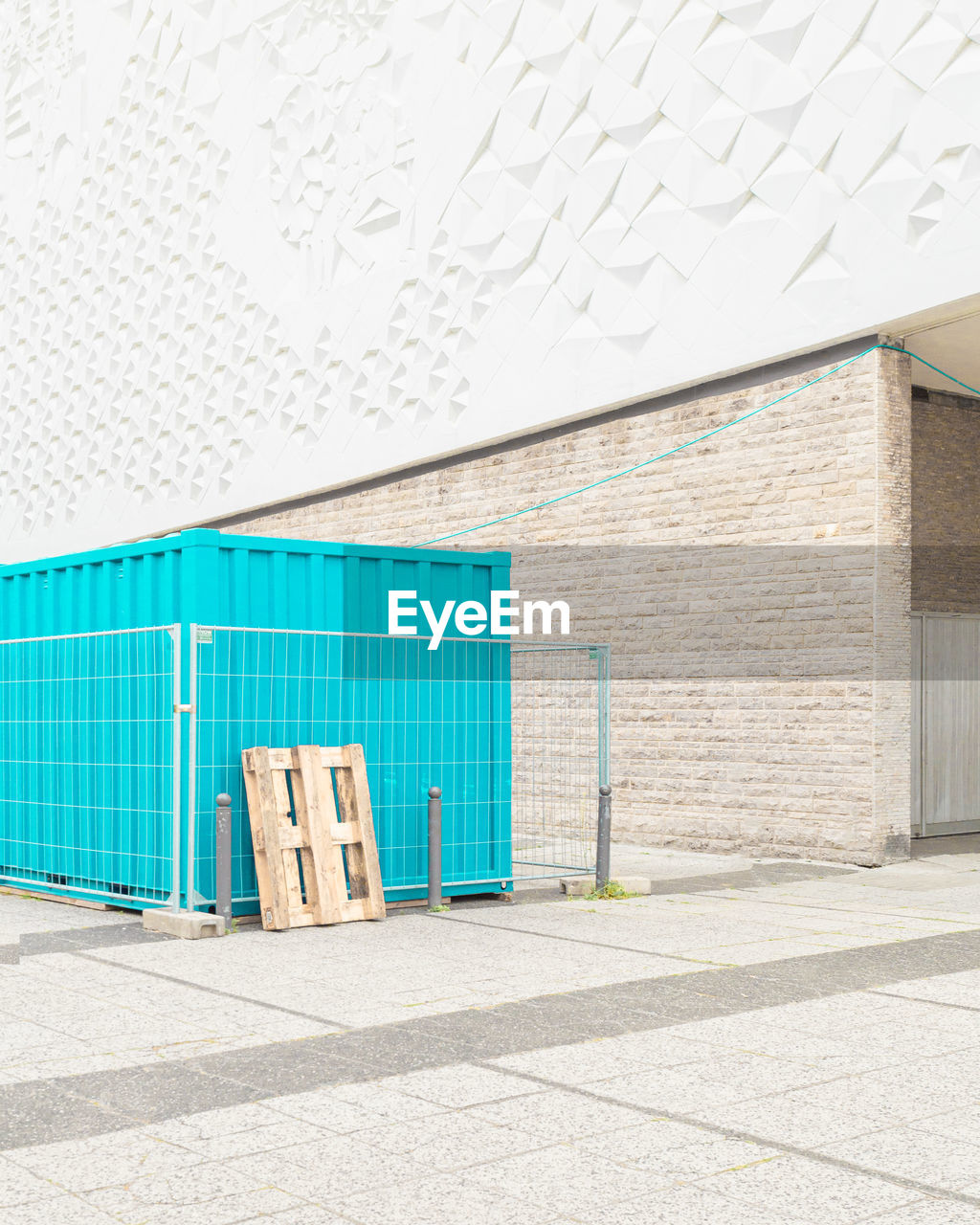Cargo container outside building