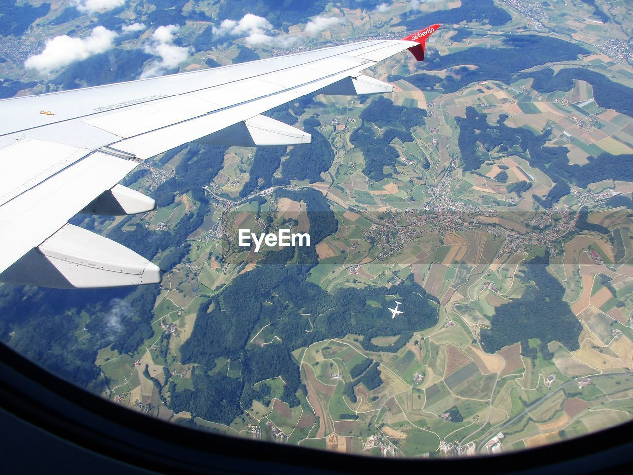 airplane, flying, aerial view, transportation, journey, aircraft wing, air vehicle, mid-air, landscape, travel, mode of transport, vehicle part, airplane wing, scenics, nature, window, beauty in nature, day, view into land, no people, patchwork landscape, agriculture, outdoors, mountain, sky