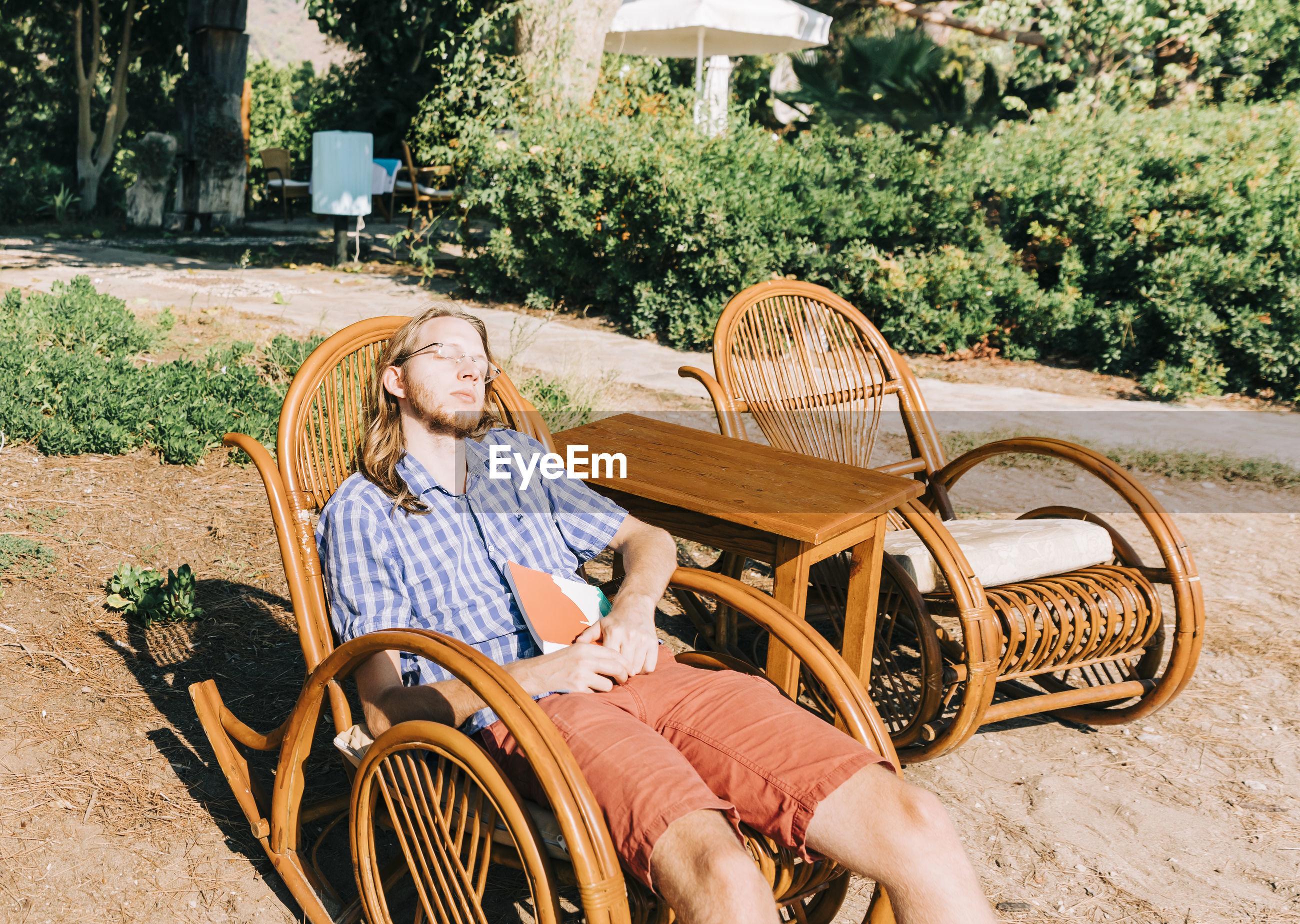 MAN SITTING IN CART