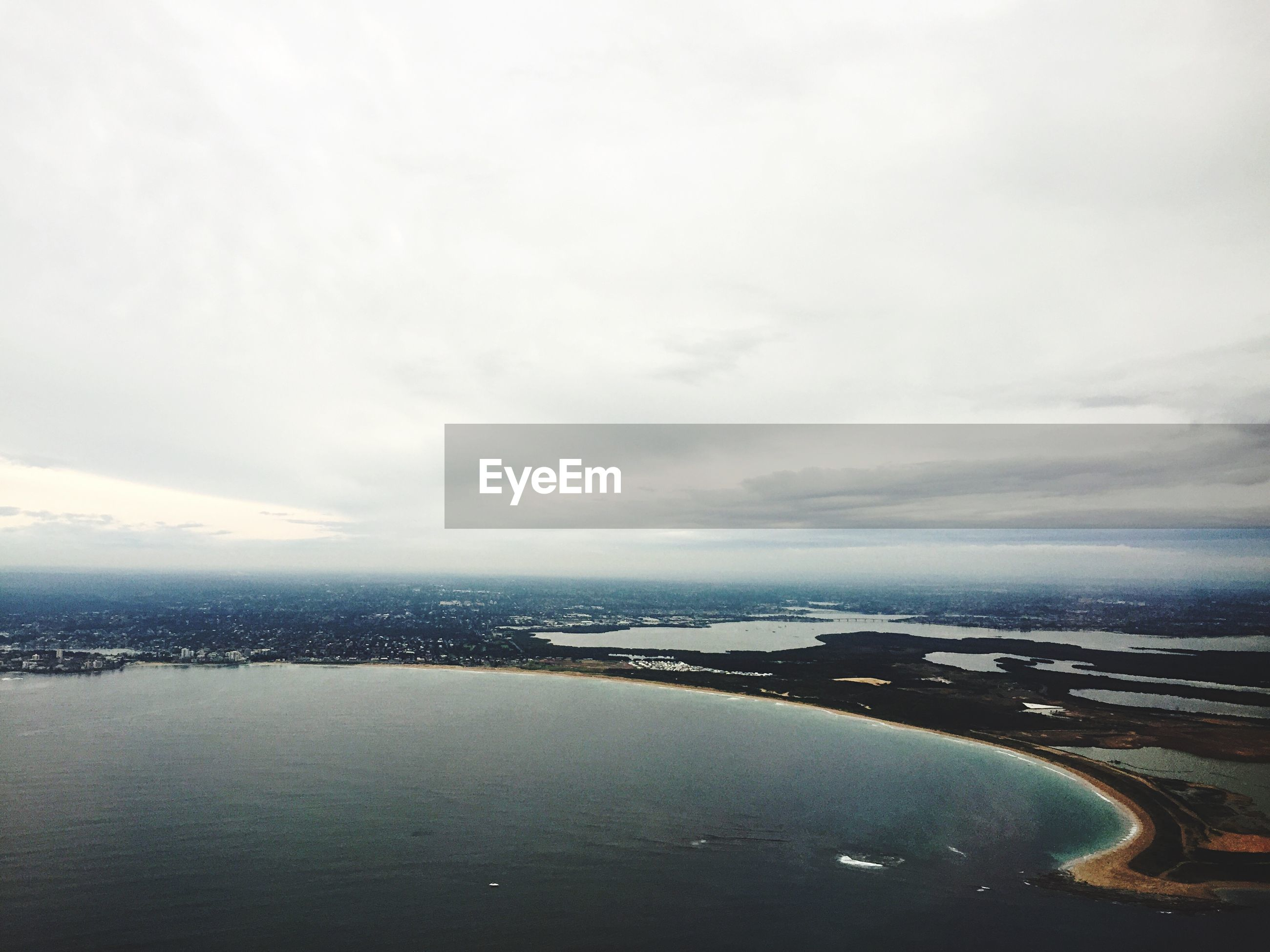 High angle view of sea against cloudy sky