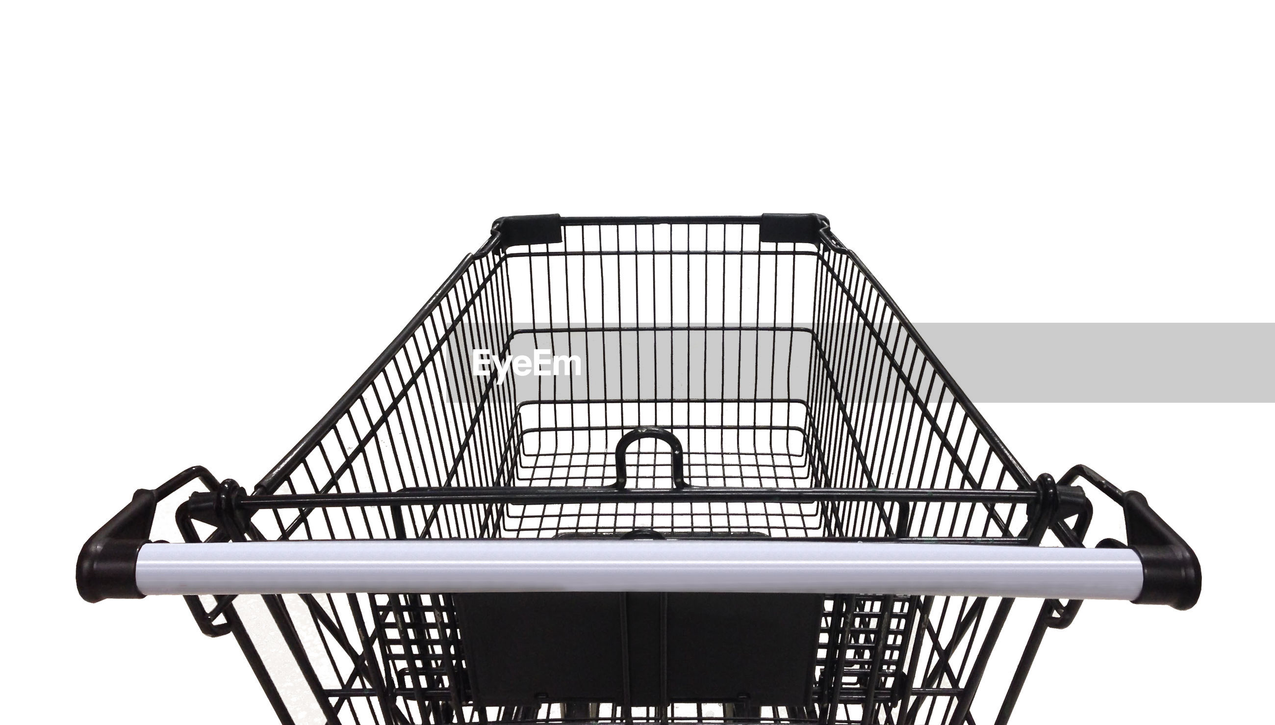 Close-up of shopping cart over white background