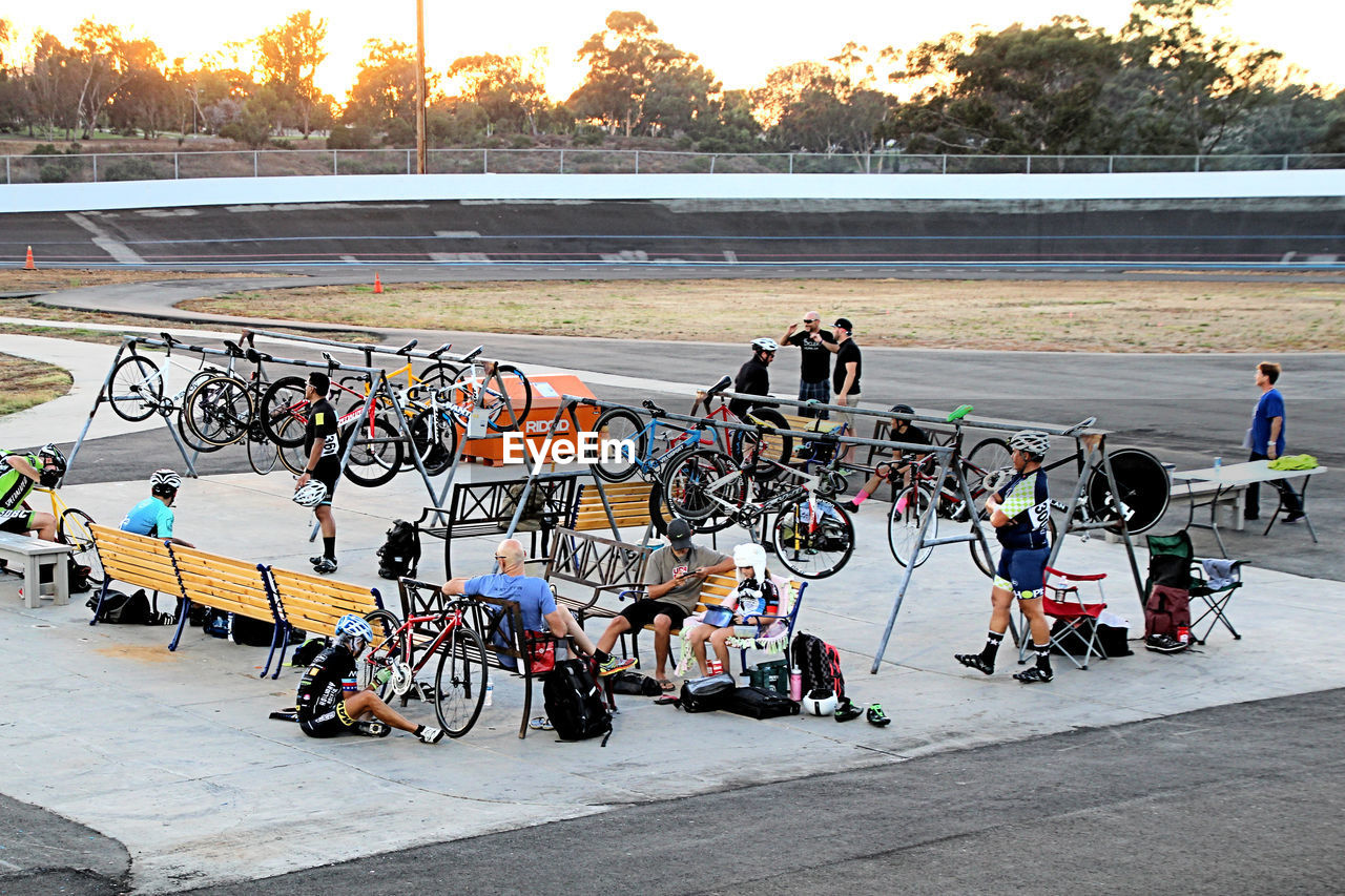 People And Bicycles On Sports Track