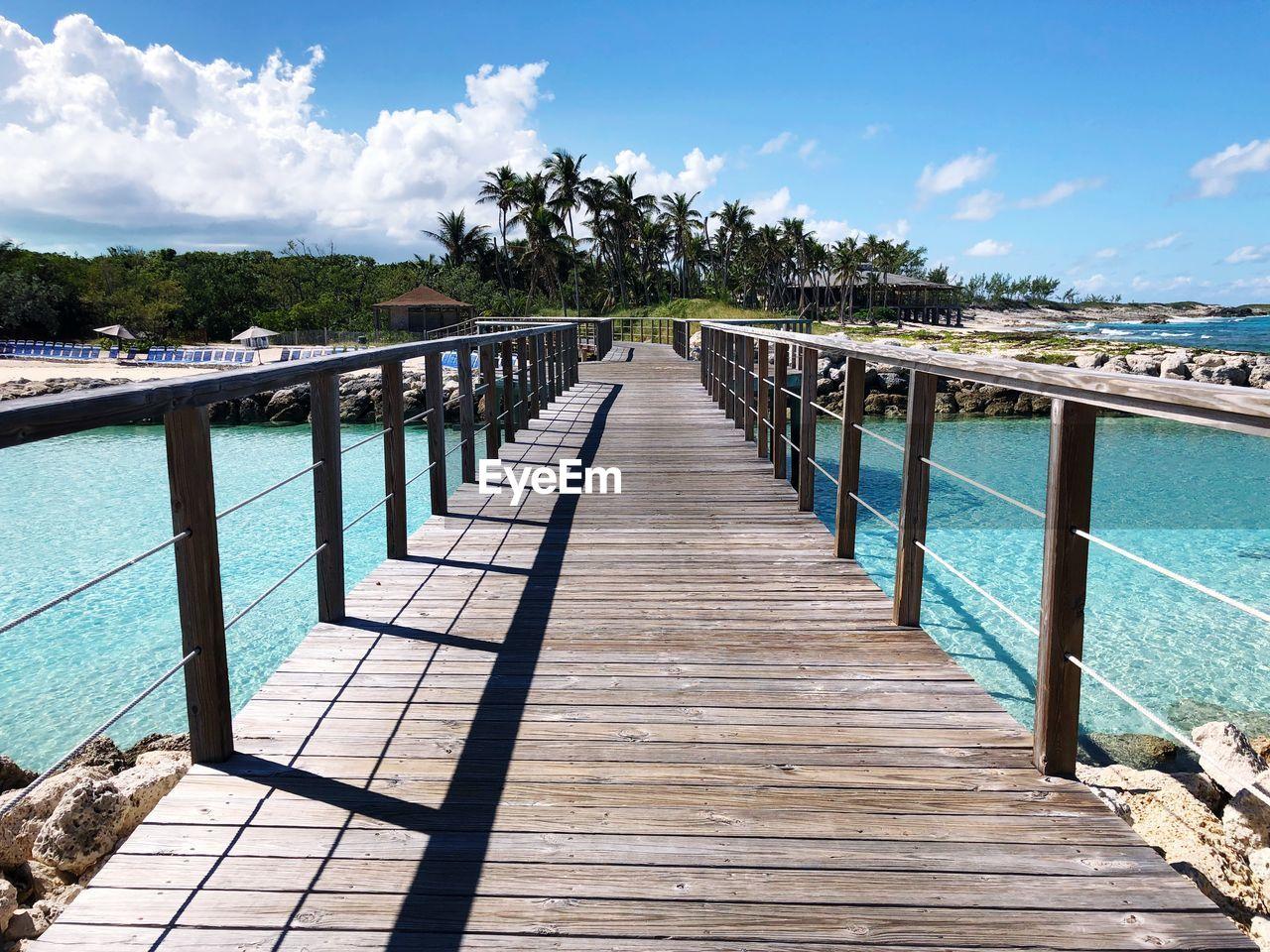 Empty wooden footbridge over sea