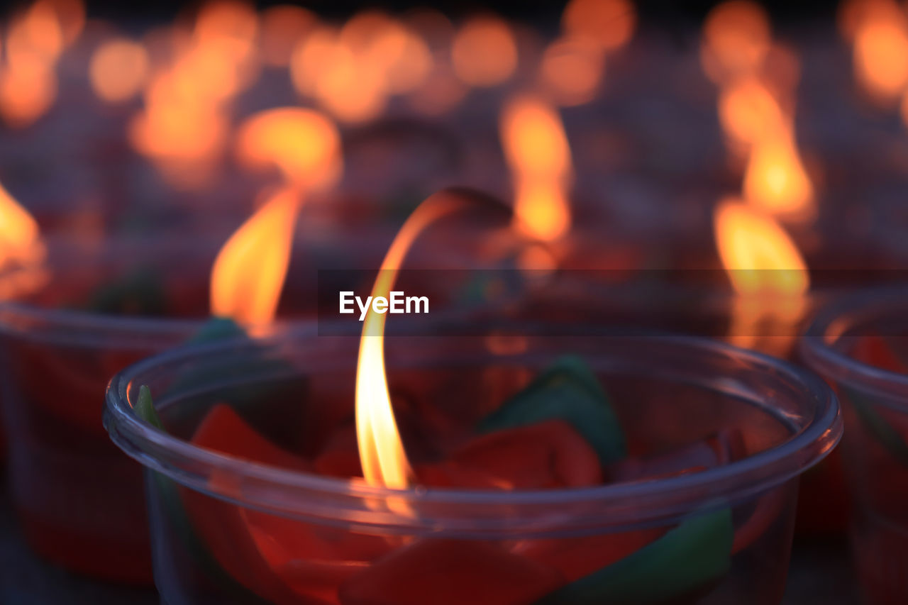 burning, fire, flame, candle, fire - natural phenomenon, close-up, indoors, focus on foreground, heat - temperature, illuminated, no people, selective focus, nature, food and drink, glowing, orange color, freshness, glass - material, container, still life, tea light, glass