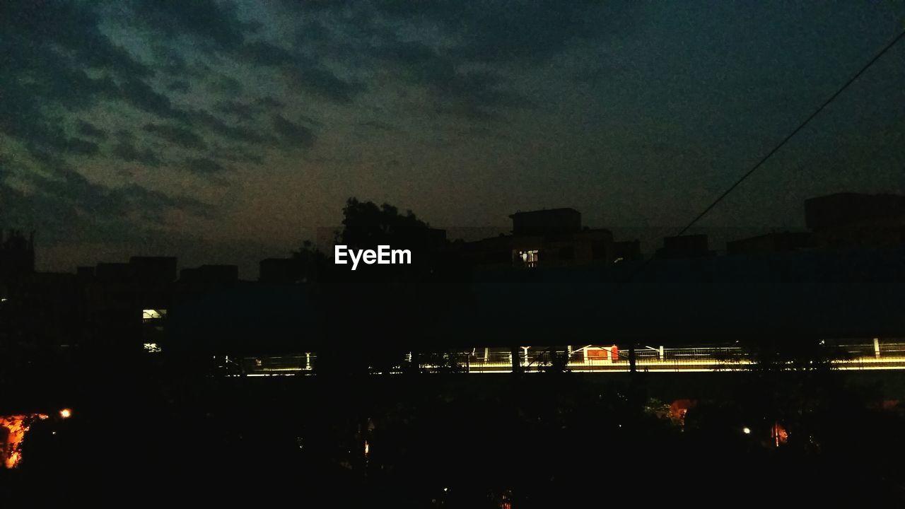 night, illuminated, dusk, city, dark, silhouette, architecture, sky, outdoors, cityscape, no people