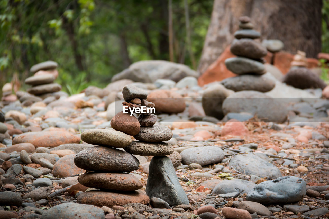 solid, rock, stone - object, balance, rock - object, stack, stone, pebble, nature, land, no people, focus on foreground, day, zen-like, outdoors, forest, tree, plant, beauty in nature, tranquility