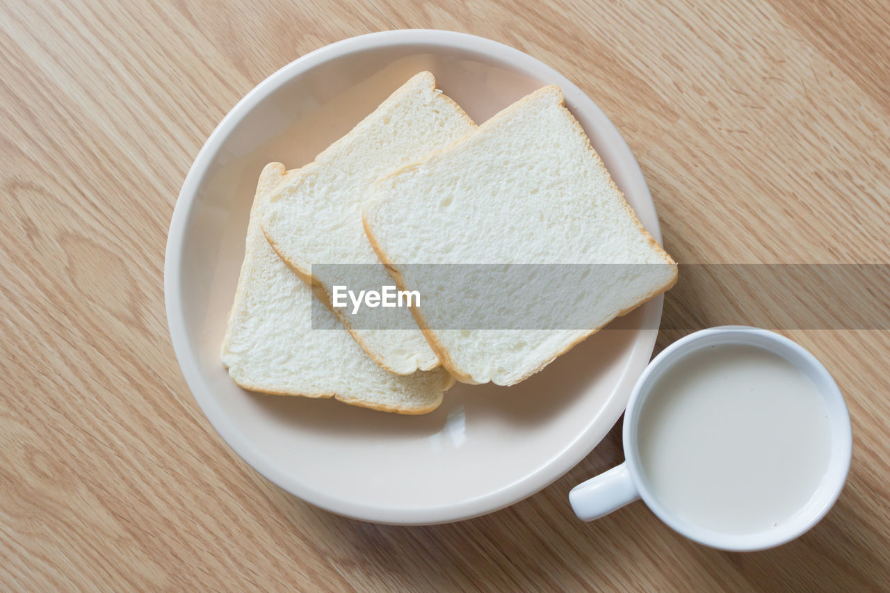 food and drink, food, bread, table, still life, freshness, wood - material, indoors, breakfast, wellbeing, high angle view, no people, close-up, directly above, healthy eating, plate, meal, bowl, cup, drink, tray, crockery