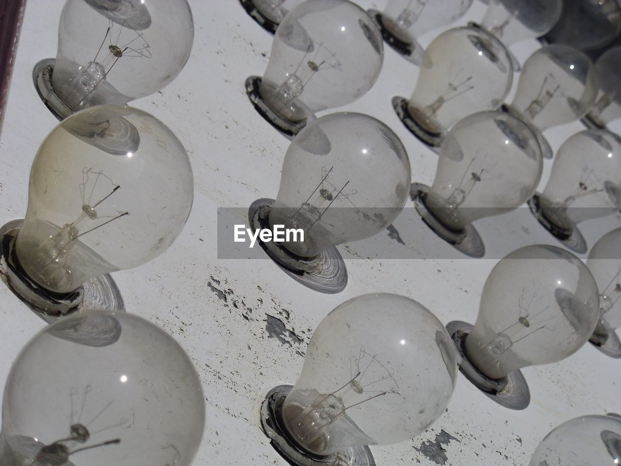no people, indoors, light bulb, large group of objects, filament, close-up, day