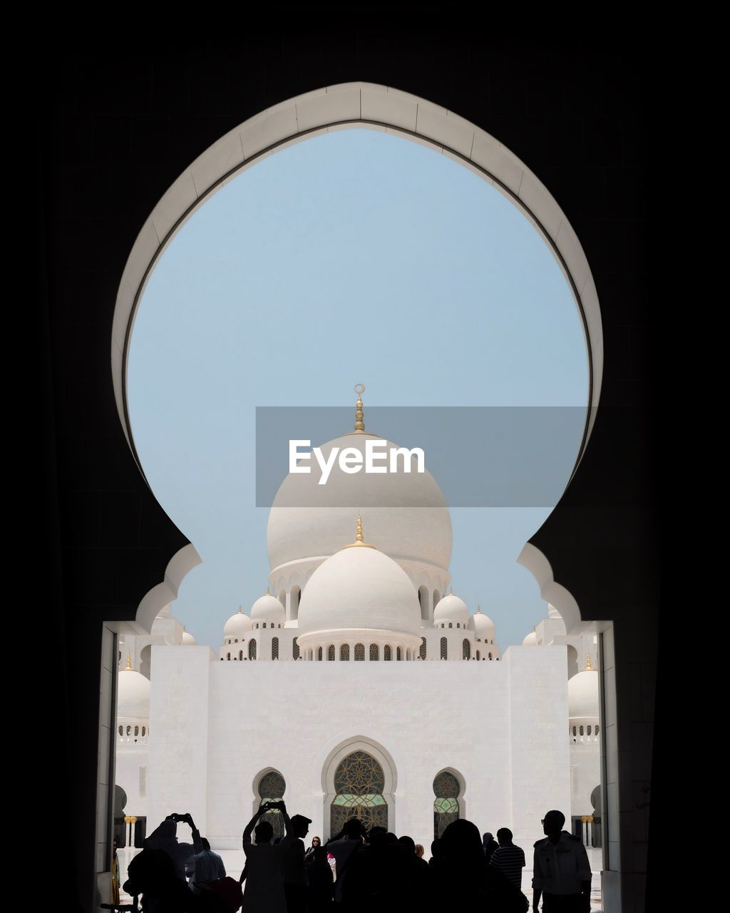 dome, building exterior, built structure, religion, architecture, clear sky, arch, spirituality, group of people, belief, place of worship, tourism, real people, sky, travel, crowd, travel destinations, large group of people, nature, outdoors