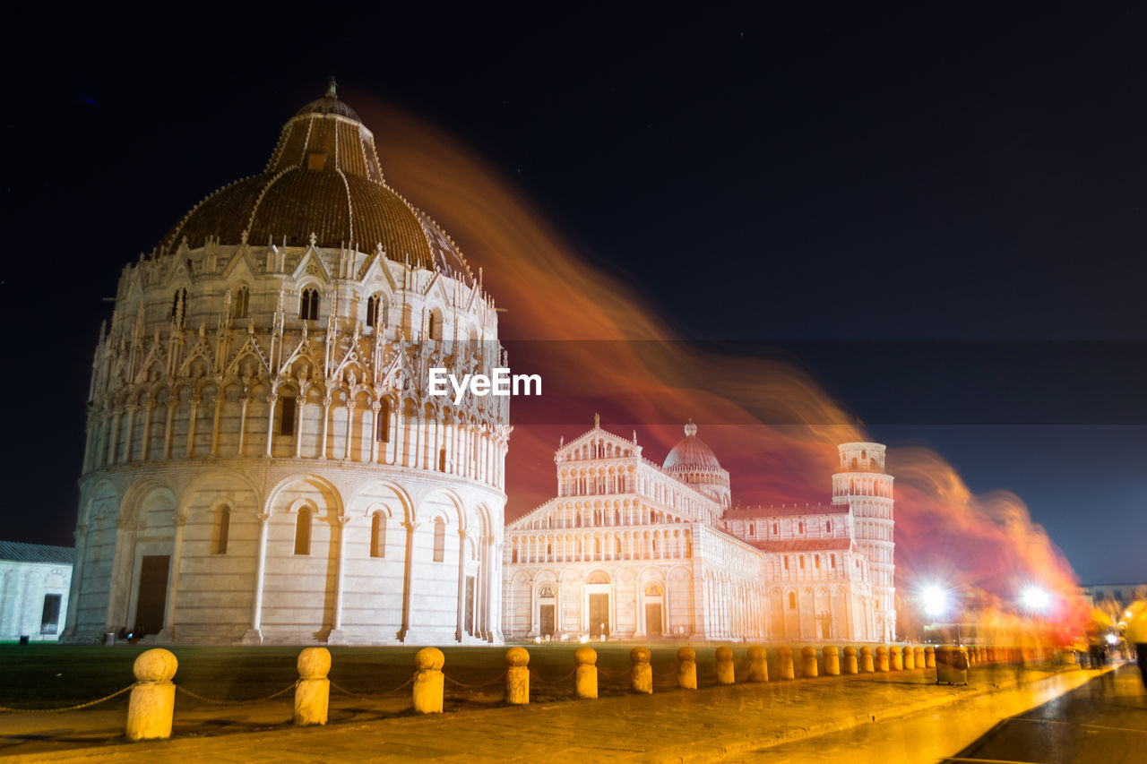 Low angle view of illuminated cathedral against sky at night