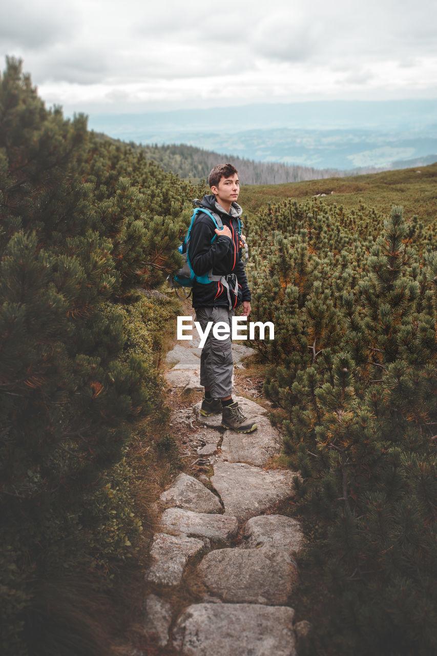 Full Length Of Man Standing On Path Against Sky