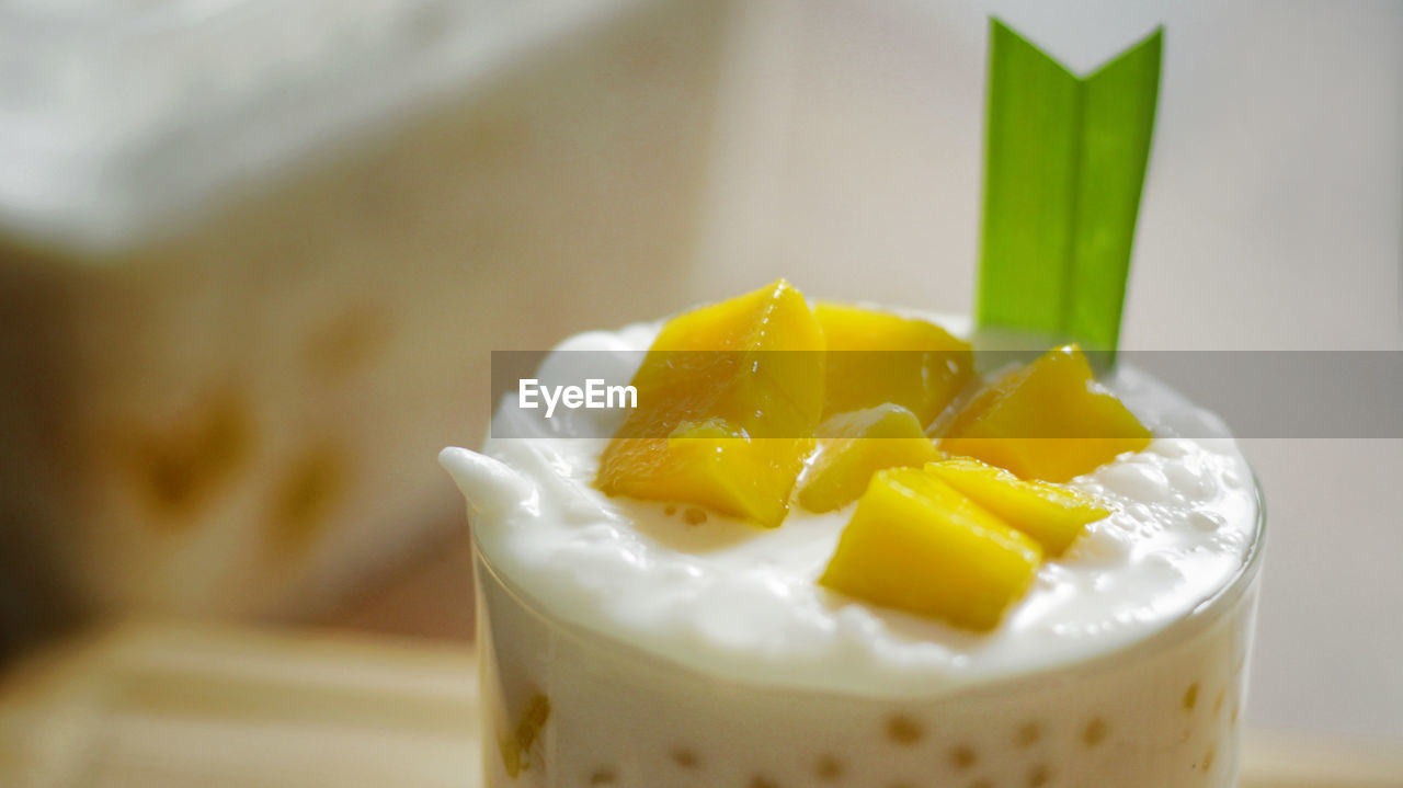 food and drink, food, close-up, freshness, still life, indoors, no people, glass, drinking glass, sweet food, indulgence, sweet, household equipment, dessert, yellow, focus on foreground, drink, ready-to-eat, dairy product, healthy eating, temptation, chopped